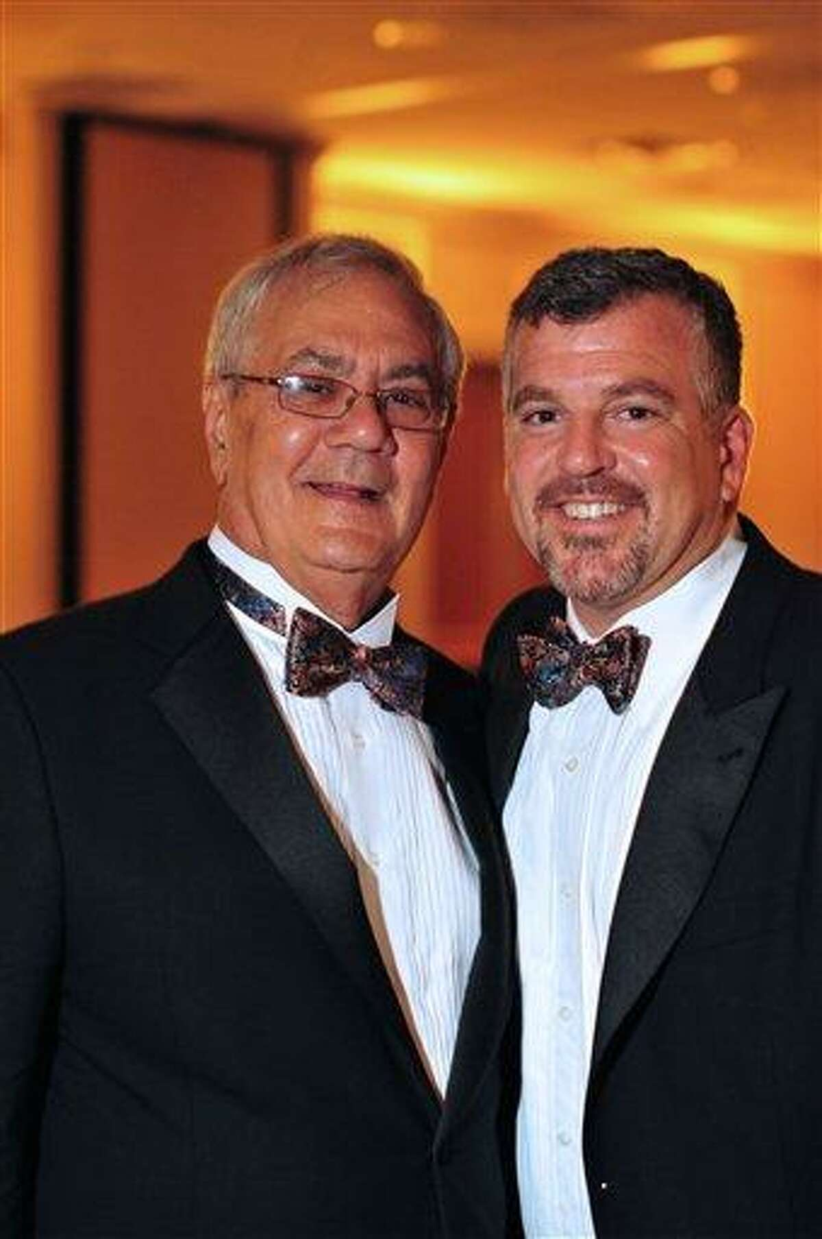 This image provided by Fotique shows U.S. Rep. Barney Frank, D-Mass., left, and Jim Ready posing at their wedding reception Saturday. Frank married his longtime partner in a ceremony officiated by Massachusetts Gov. Deval Patrick in Newton, Mass. Associated Press