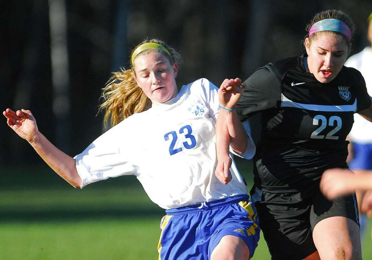 Catherine Avalone/The Middletown PressMercy sophomore Kendra Landy battles Trumbull junior Nicole Schwartz in a semi final match for the CIAC Class L State Championship Wednesday afternoon. Mercy lost 3-1.