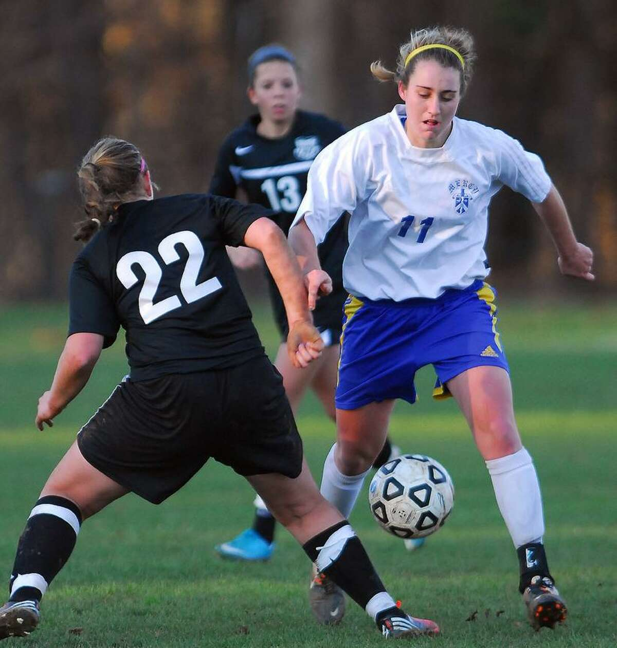 Catherine Avalone/The Middletown Press Mercy senior Sheena Landy battles Trumbull's Nicole Schwartz in their Class LL quarterfinal game Wednesday in Middletown. Trumbull won, 3-1.