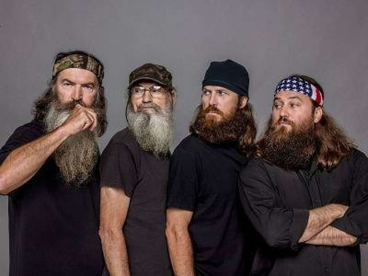 """Phil, Si, Jase and Willie Robertson from A&E's """"Duck Dynasty."""" Amid the nation's economic downturn, """"Duck Dynasty"""" has touched a nerve with viewers who have become turned off by the gaudy, materialistic shenanigans of other reality shows. (A&E Networks)"""