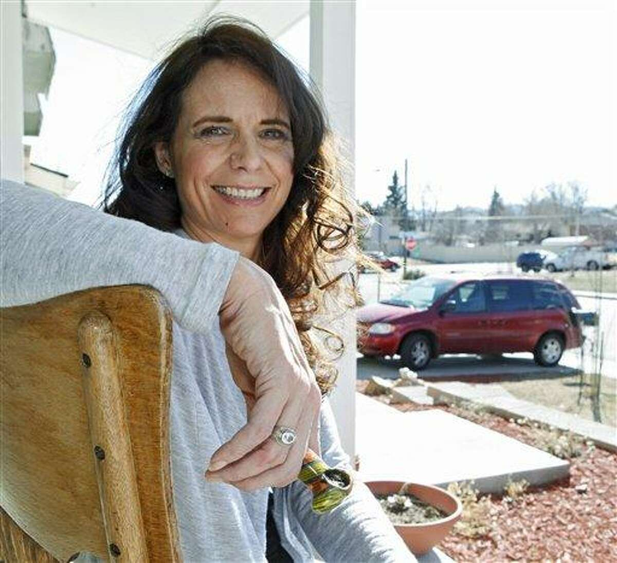Angeline Chilton a suburban Denver woman with multiple sclerosis who smokes pot twice a day to ease tremors, holds her pipe March 6 as she sits on the front porch of her home in Lakewood, Colo. Chilton insists that she never drives high, but she fears that officials will rush to set an unproven blood-level standard that would put her at risk of breaking the law. In Colorado and Washington, the debate over how to tell whether a driver is high is more than academic. The states are struggling to come up with a blood-level standard for marijuana that would be analogous to the blood-alcohol standard used to decide who's driving drunk. Associated Press