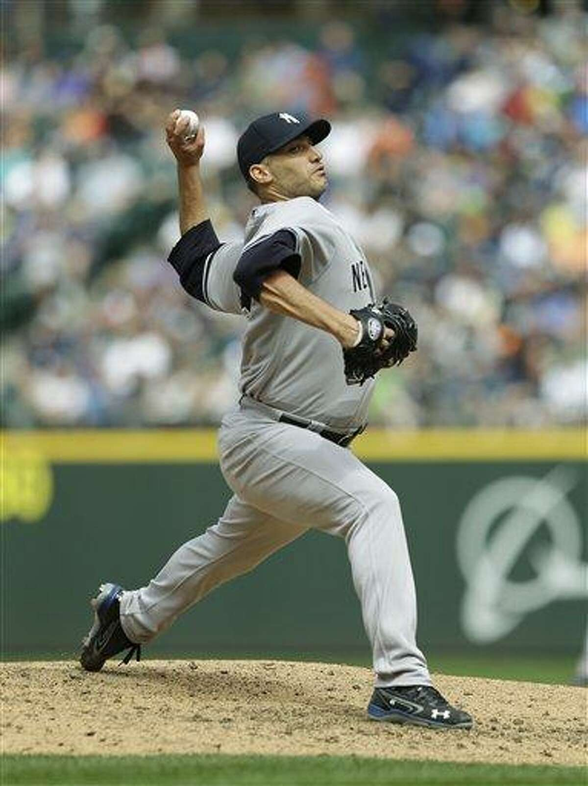 New York Yankees pitcher Andy Pettitte throws during a baseball game against the Seattle Mariners, Saturday, June 8, 2013, in Seattle. (AP Photo/Ted S. Warren)