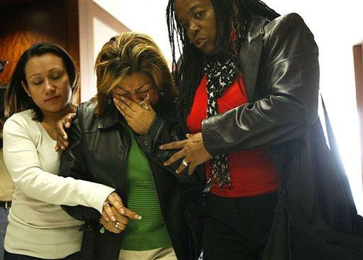 Rosie Castillo, center, grandmother of 16-month-old day care fire victim, Elias Castillo, reacts after walking out of closing arguments where home day care operator Jessica Tata is on trial for one count of felony murder at the Harris County Criminal Justice Center. AP Photo/Houston Chronicle, Johnny Hanson