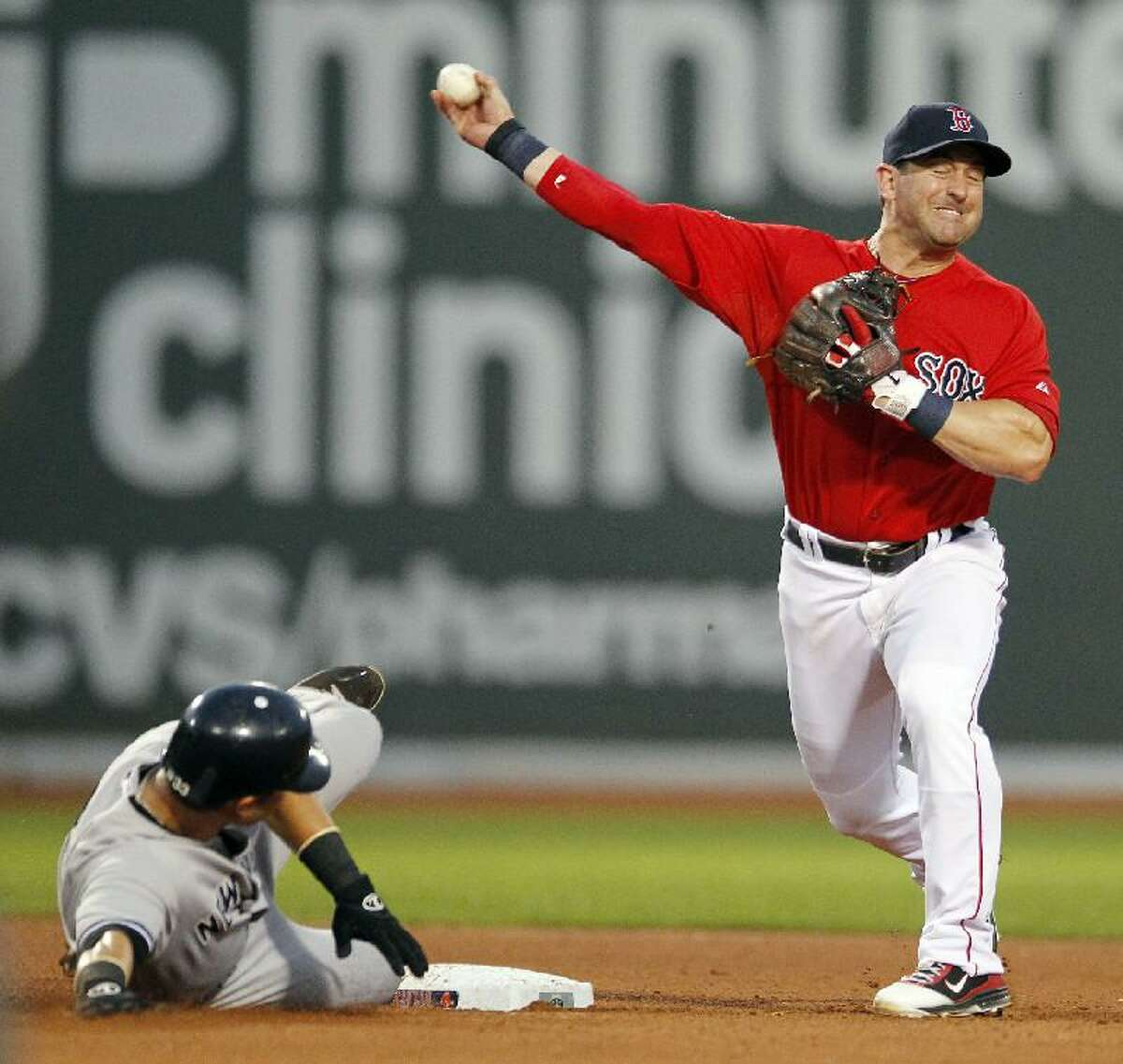 ASSOCIATED PRESS New York Yankees' Nick Swisher, left, is forced out at second base but Boston Red Sox's Nick Punto cannot complete the double play during the fourth inning of the second game of a doubleheader at Fenway Park in Boston. The Red Sox won 9-5.