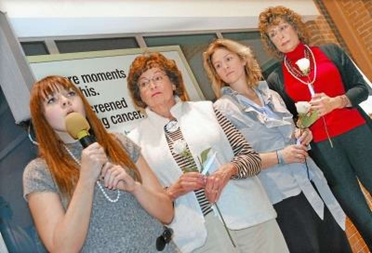 """Catherine Avalone/The Middletown Press Caitlin Havican, left, sings """"Somewhere over the Rainbow"""" during the National Lung Cancer Vigil sponsored by the Lung Cancer Alliance at Middlesex Hospital Cancer Center at 540 Saybrook Road in Middletown. Listening, left to right, are cancer survivors Karen Nicholls of Madison, Ashley Vincent of Killingworth and Ann Cushion of West Haven."""