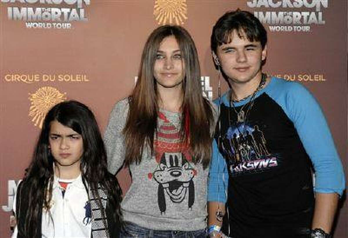 This Jan. 27, 2012 file photo shows, from left, Blanket Jackson, Paris Jackson, and Prince Michael Jackson at the opening night of the Michael Jackson The Immortal World Tour in Los Angeles. Paris Jackson is physically fine after being taken to a hospital early Wednesday, June 5, 2013, an attorney for Jackson's mother said. Perry Sanders Jr. writes in a statement that Paris Jackson is getting appropriate medical attention and the family is seeking privacy. Fire and sheriff's officials confirmed they transported someone from a home in Paris' suburban Calabasas neighborhood for a possible overdose but did not release any identifying information or additional details.