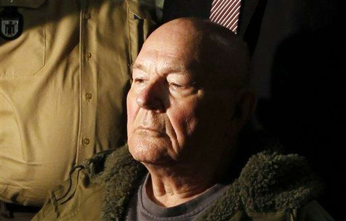 In this May file picture, John Demjanjuk waits in a courtroom in Munich. German police say John Demjanjuk, who was charged with 28,060 counts of accessory to murder and convicted last year of serving as a Nazi death camp guard, has died. Associated Press