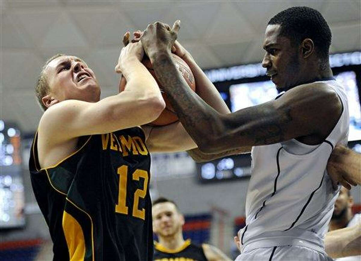 Vermont's Sandro Carissimo, left, and Connecticut's Phillip Nolan fight for a rebound during the first half of an NCAA college basketball game against, Tuesday, Nov. 13, 2012, in Storrs, Conn. (AP Photo/Jessica Hill)