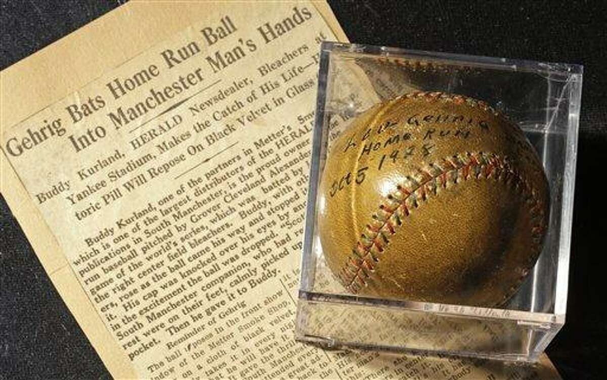 A baseball that New York Yankees slugger Lou Gehrig hit for a World Series home run in 1928 is on display at a convention center in Kansas City, Mo., Thursday, July 5, 2012. Stamford, Conn., resident Elizabeth Gott, is selling the baseball at auction on behalf of her 30-year-old son, Michael to help pay off his medical school debts. (AP Photo/Charlie Riedel)