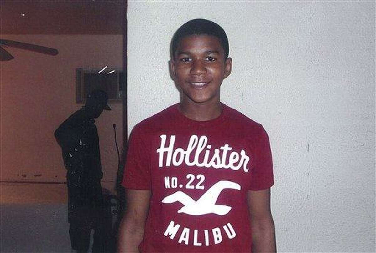 In this undated family photo, Trayvon Martin poses for a family photo. The family of the black teenager fatally shot by a white neighborhood watch volunteer arrived at Sanford City Hall Friday evening March 16, 2012 to listen to recordings of 911 calls police previously refused to release. Police agreed to release the recordings earlier that afternoon. Officials are allowing the family of 17-year-old Trayvon Martin to hear the recordings before making them public. Martin's parents previously sued to have the recordings released. A hearing for the case was scheduled for Monday. Martin was fatally shot last month as he returned to a Sanford home during a visit from Miami. His parents, Tracy Martin and Sybrina Fulton, accused Sanford police of botching the investigation and criticized them for not arresting 28-year-old George Zimmerman, who says he shot Trayvon Martin in self-defense. Martin was not armed. They say the police department hasn't arrested Zimmerman because he is white and their son was black. (AP Photo/HO, Martin Family Photos)