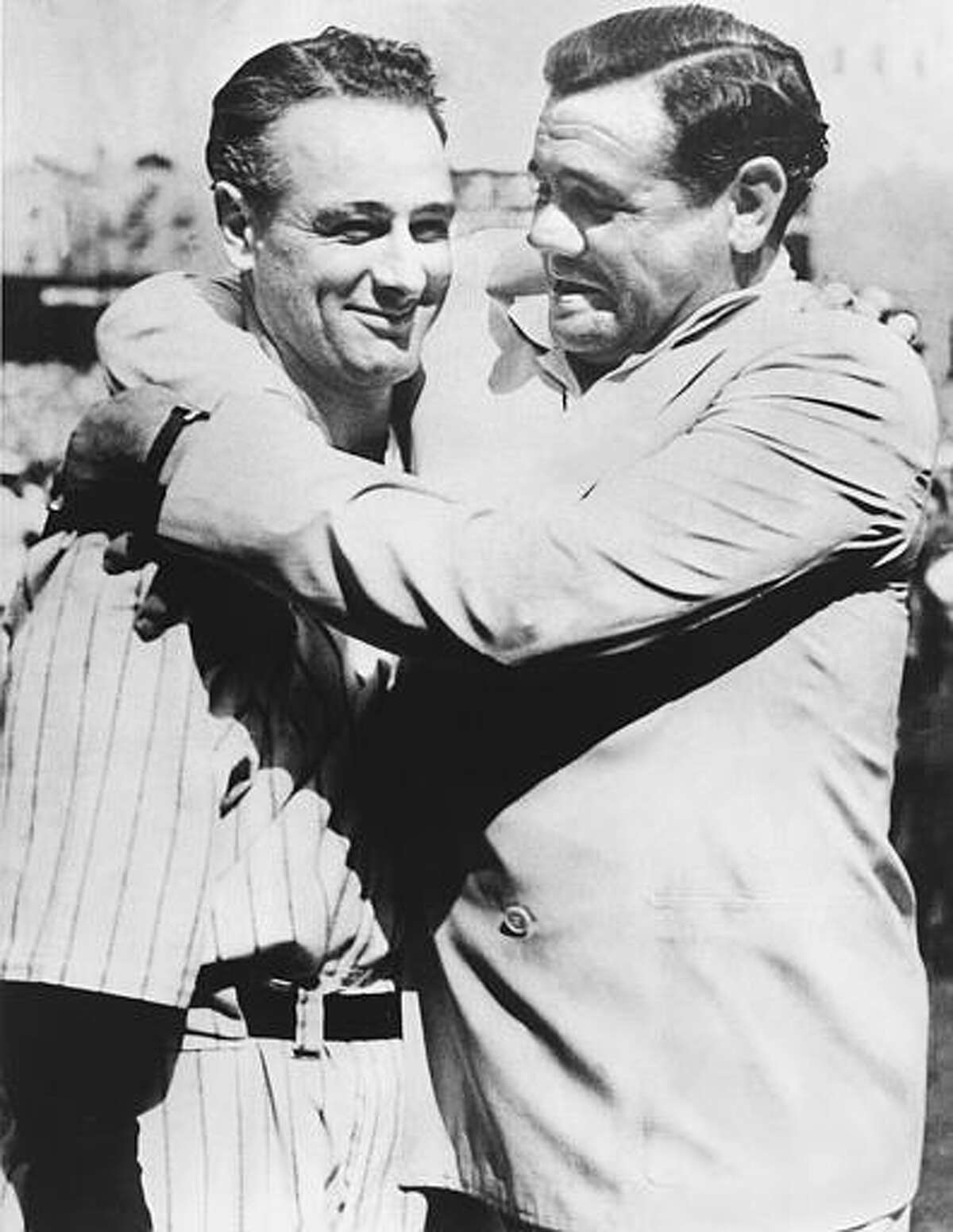 Babe Ruth, right, immortal New York Yankee baseball player comforts Lou Gehrig, who was almost too moved to speak to the vast throng which acclaimed him at Yankee Stadium July 4, 1939 where the Yankees met the Washington Senators in a doubleheader. Gehrig, famed iron man of the Yankees, was honored by players and fans. As an added honor, the world championship flag that the Yankees won in 1927 with a team hailed as one of baseball's greatest was unfurled at the stadium. (AP Photo)