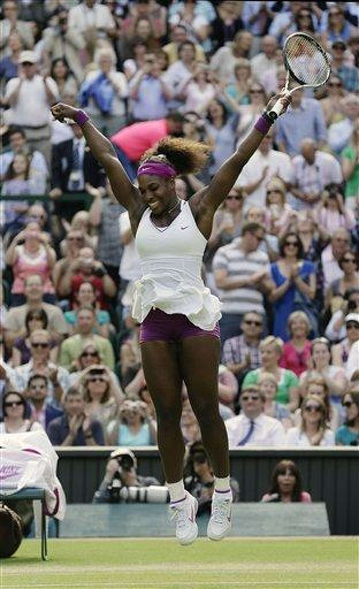 Serena Williams of the United States reacts after defeating Victoria Azarenka of Belarus during a semifinals match at the All England Lawn Tennis Championships at Wimbledon, England, Thursday, July 5, 2012. (AP Photo/Anja Niedringhaus)