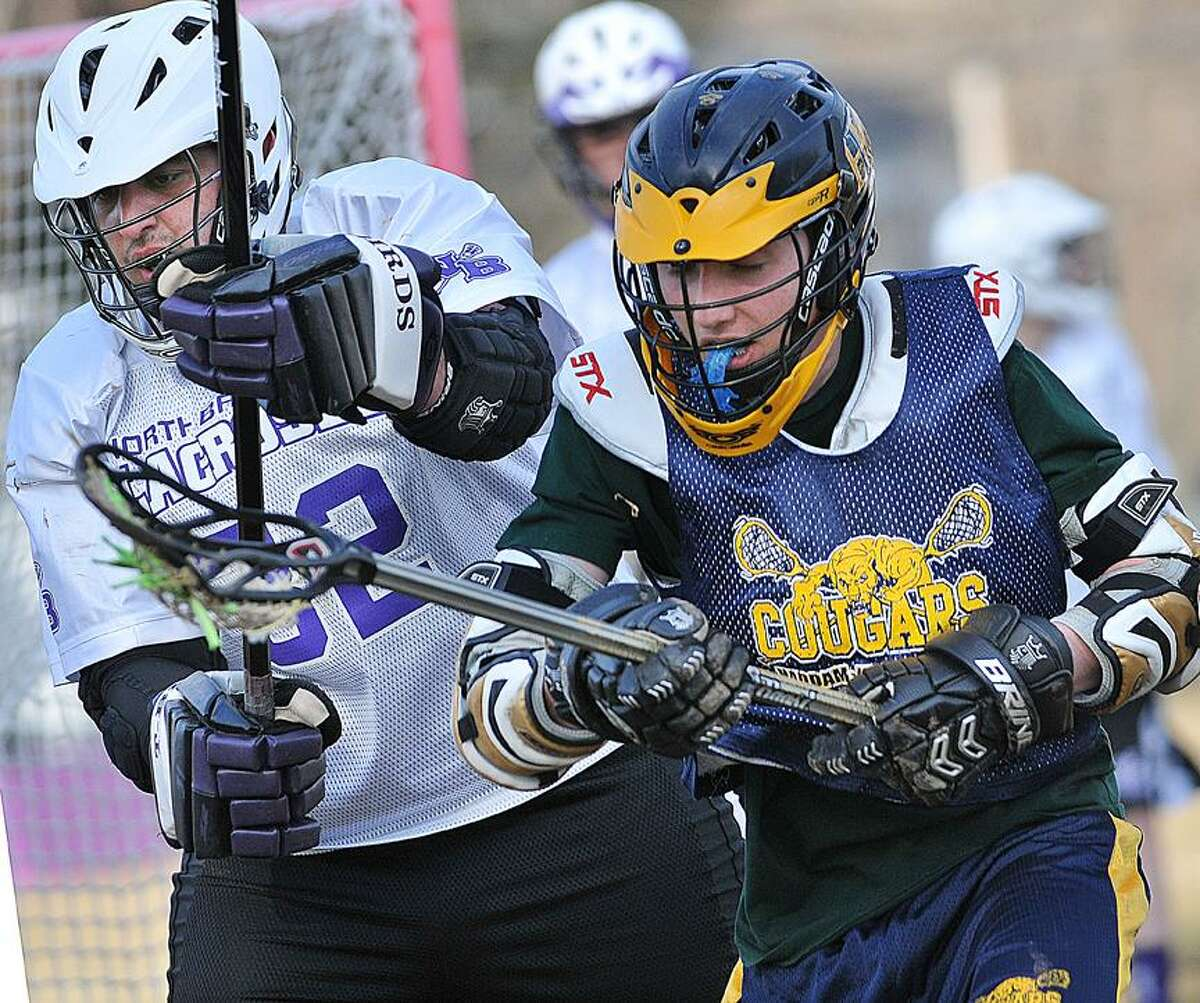 Catherine Avalone/The Middletown Press. H-K boys lacrosse scrimmages with North Branford Tuesday.