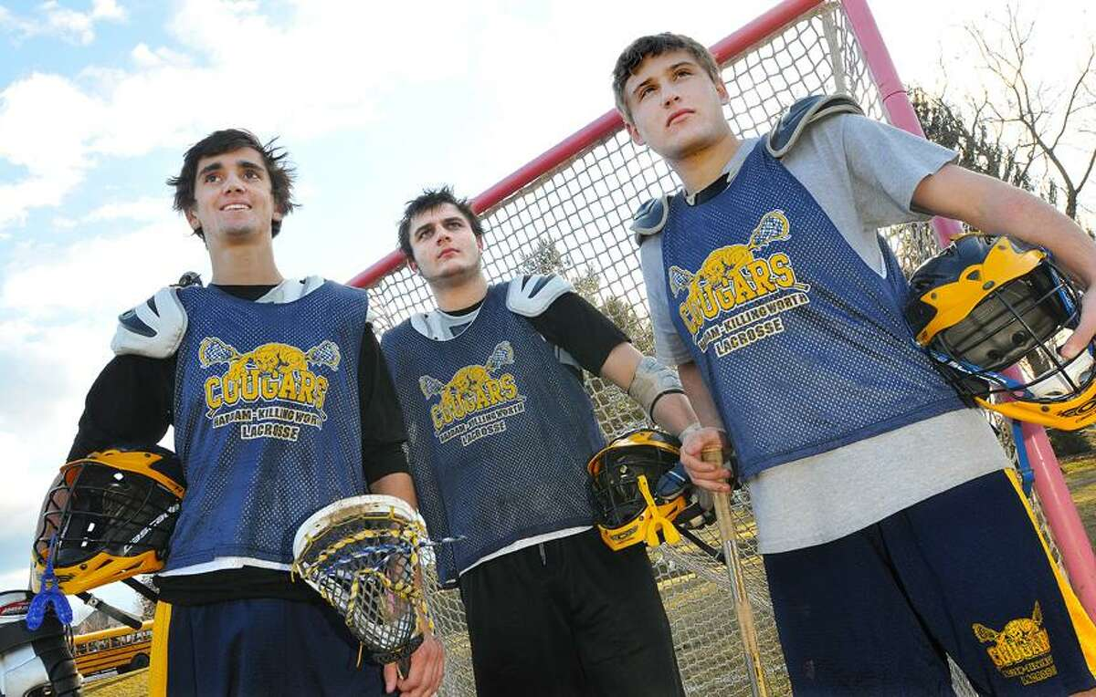Catherine Avalone/The Middletown Press Haddam-Killingworth boys lacrosse senior captains: Hunter Herrington, Sebastian Barbagallo and Eric Egri.