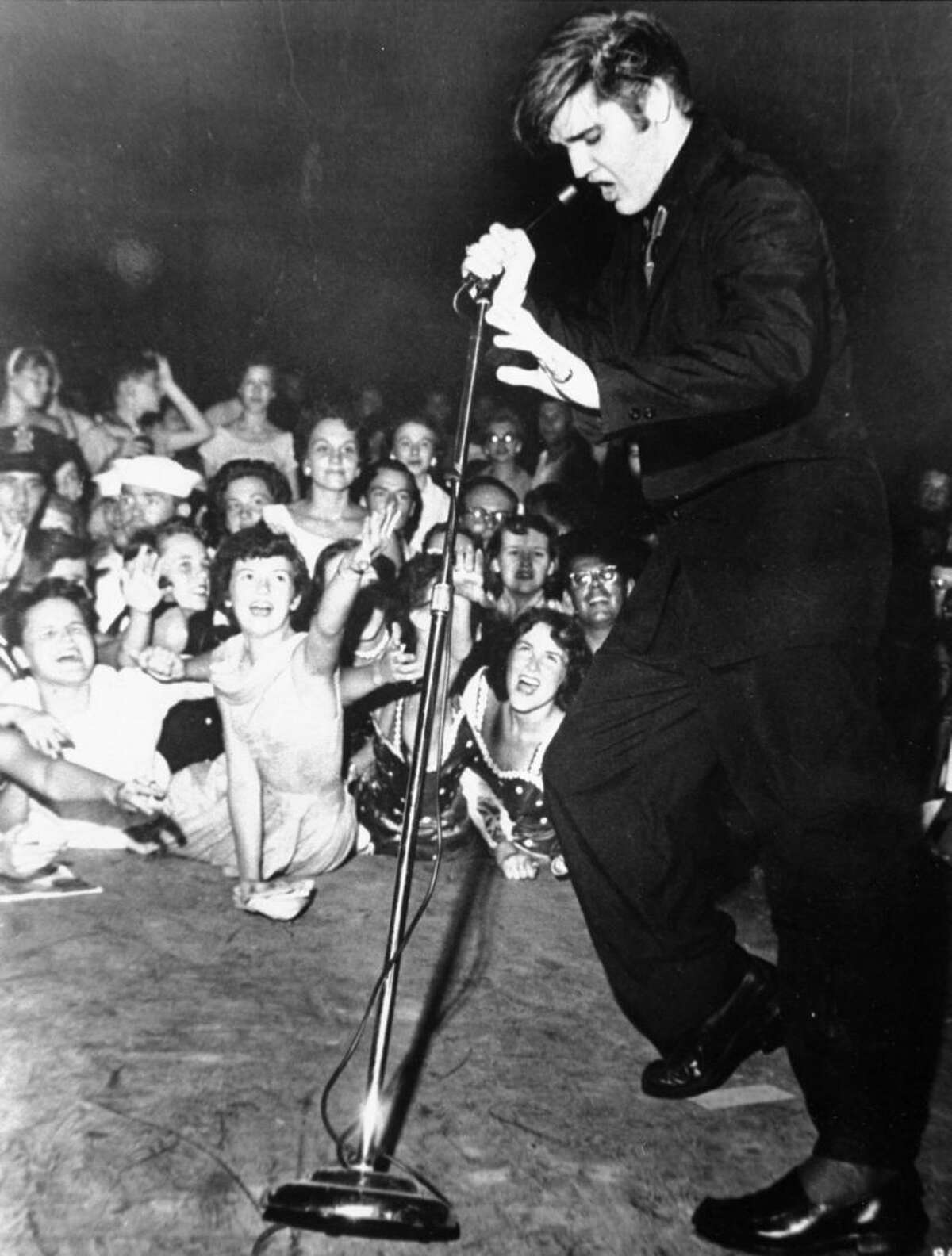 Elvis Presley shakes, rattles, and rolls as he performs at the Mississippi-Alabama State Fair, Tupelo, Mississippi, September 27, 1956. (AP Photo/RCA Victor)