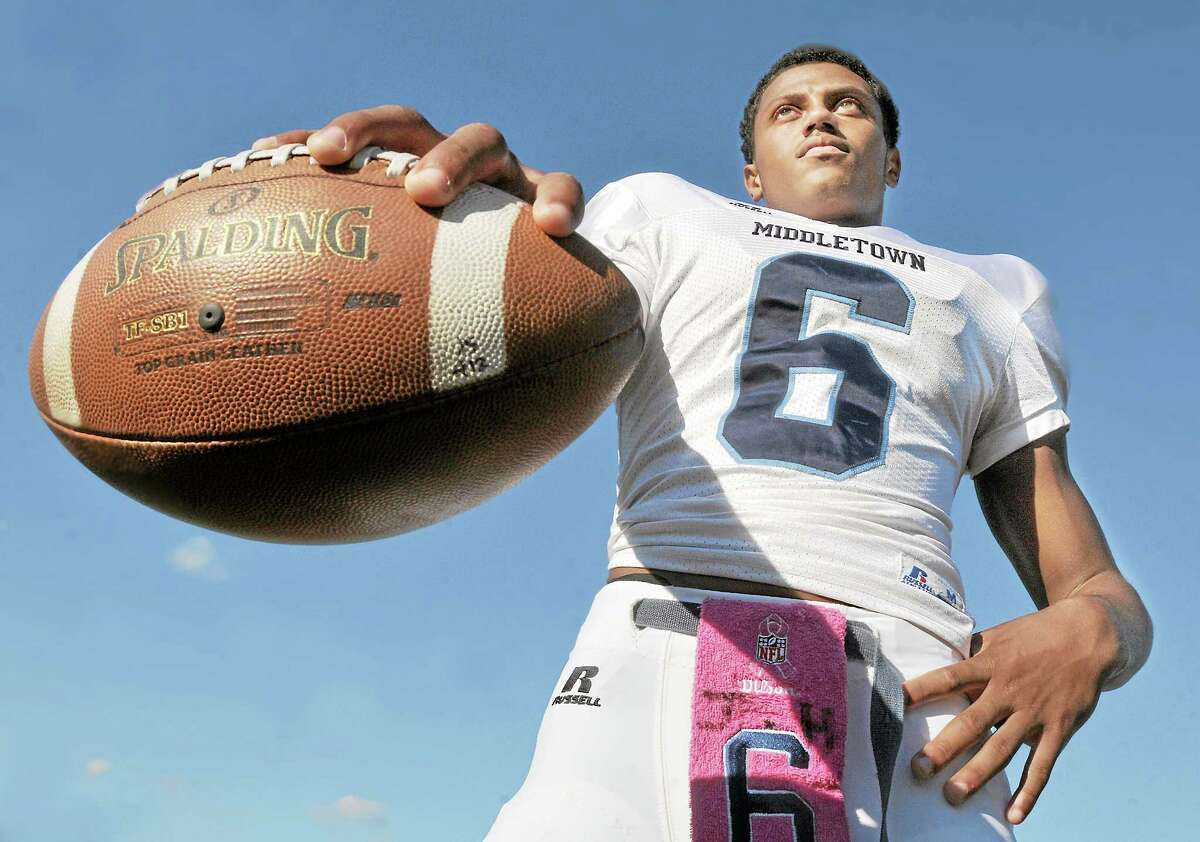 Catherine Avalone — The Middletown Press Middletown's junior quarterback, Dario R. Highsmith, Jr. has helped the Blue Dragons to No. 4 in the state.