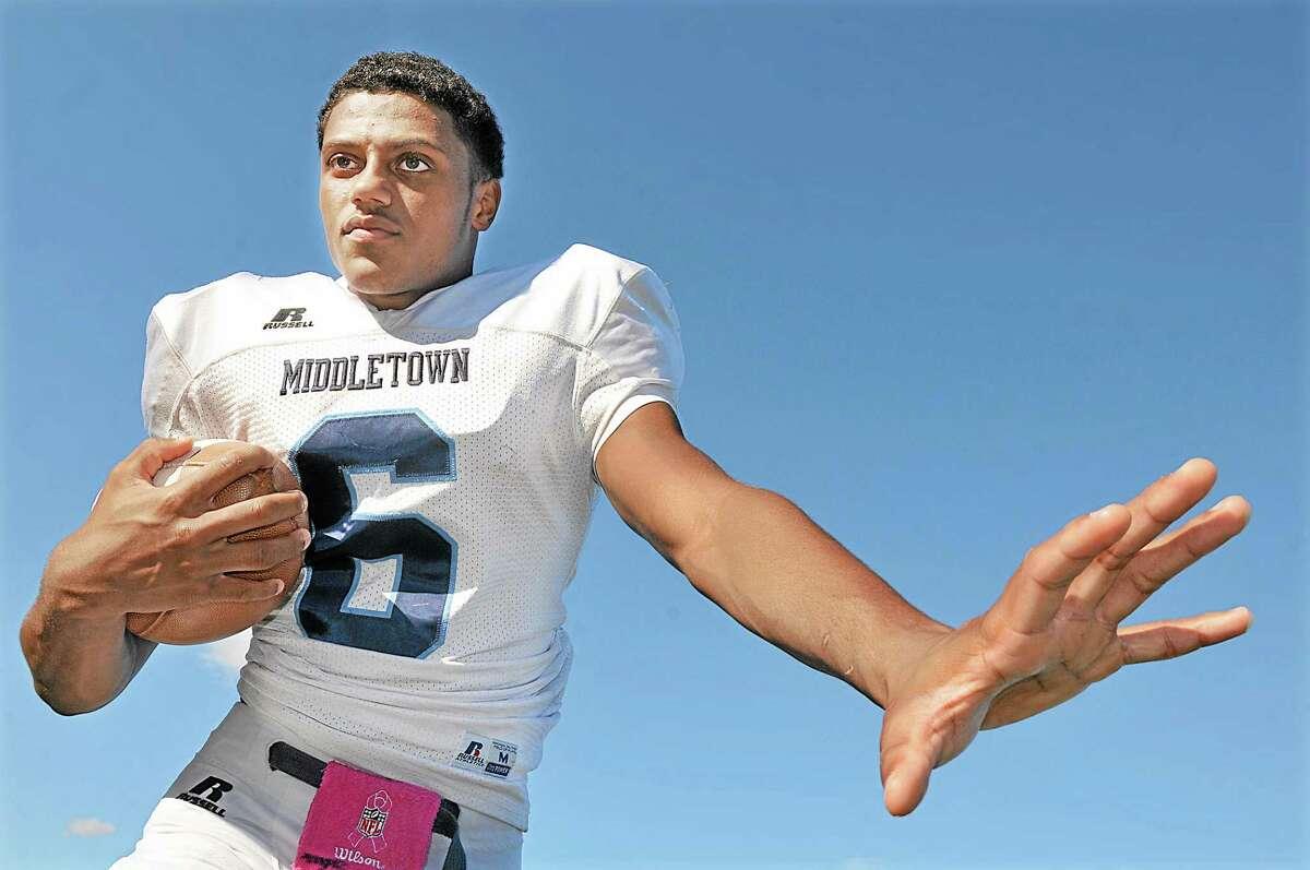 Middletown's junior quarterback, Dario R. Highsmith, Jr. Catherine Avalone - The Middletown Press