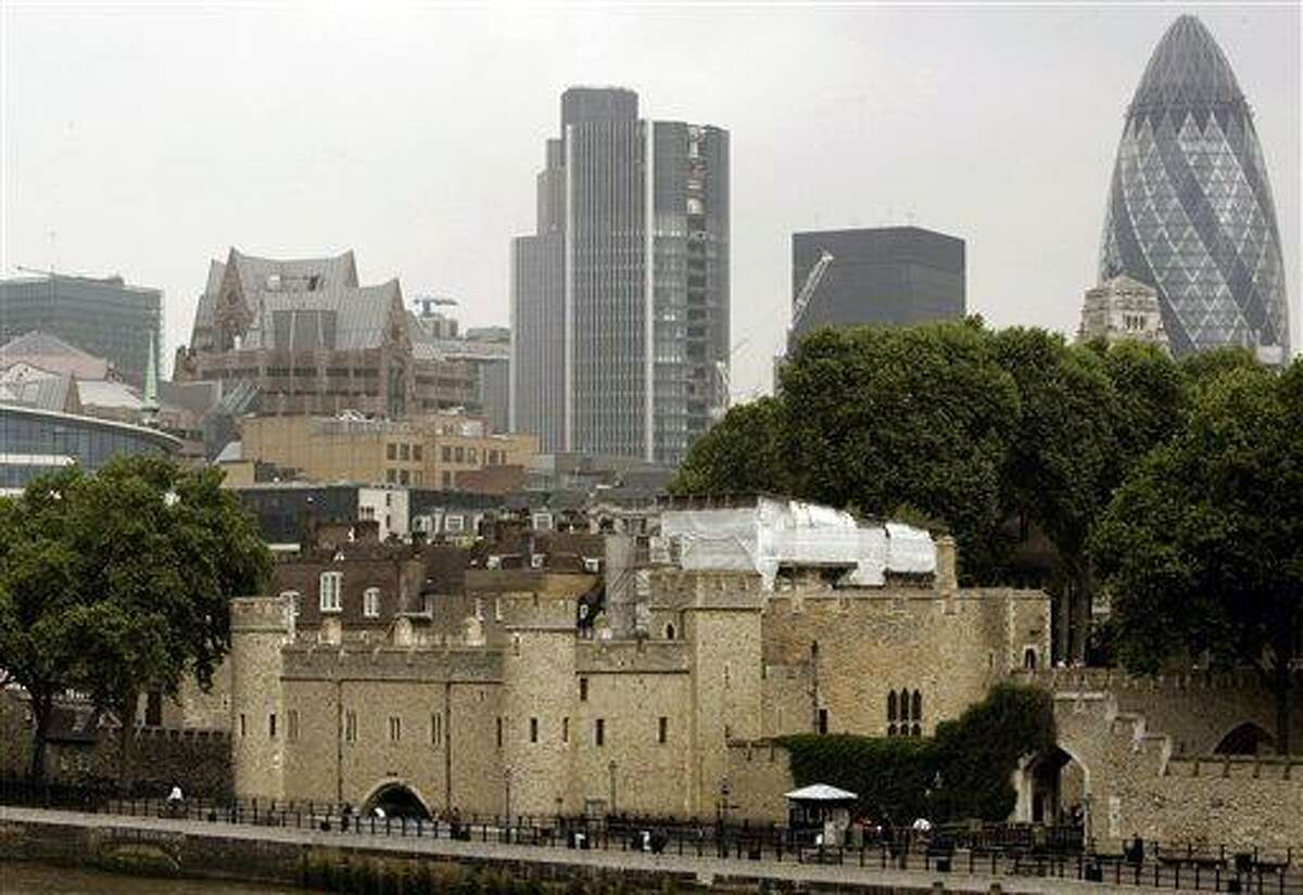 This 2007 file photo shows the Tower of London, foreground, surrounded by modern buildings in London. Associated Press
