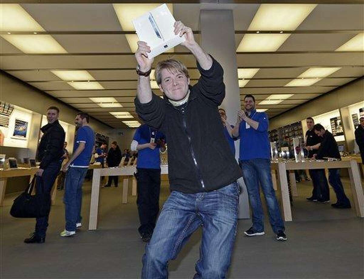 Lukas from Germany is the first to get the new iPad at the Apple store in a shopping mall in Oberhausen, western Germany, Friday. Apart from a few countries, there is an internationally coordinated simultaneous release of the iPad. Associated Press