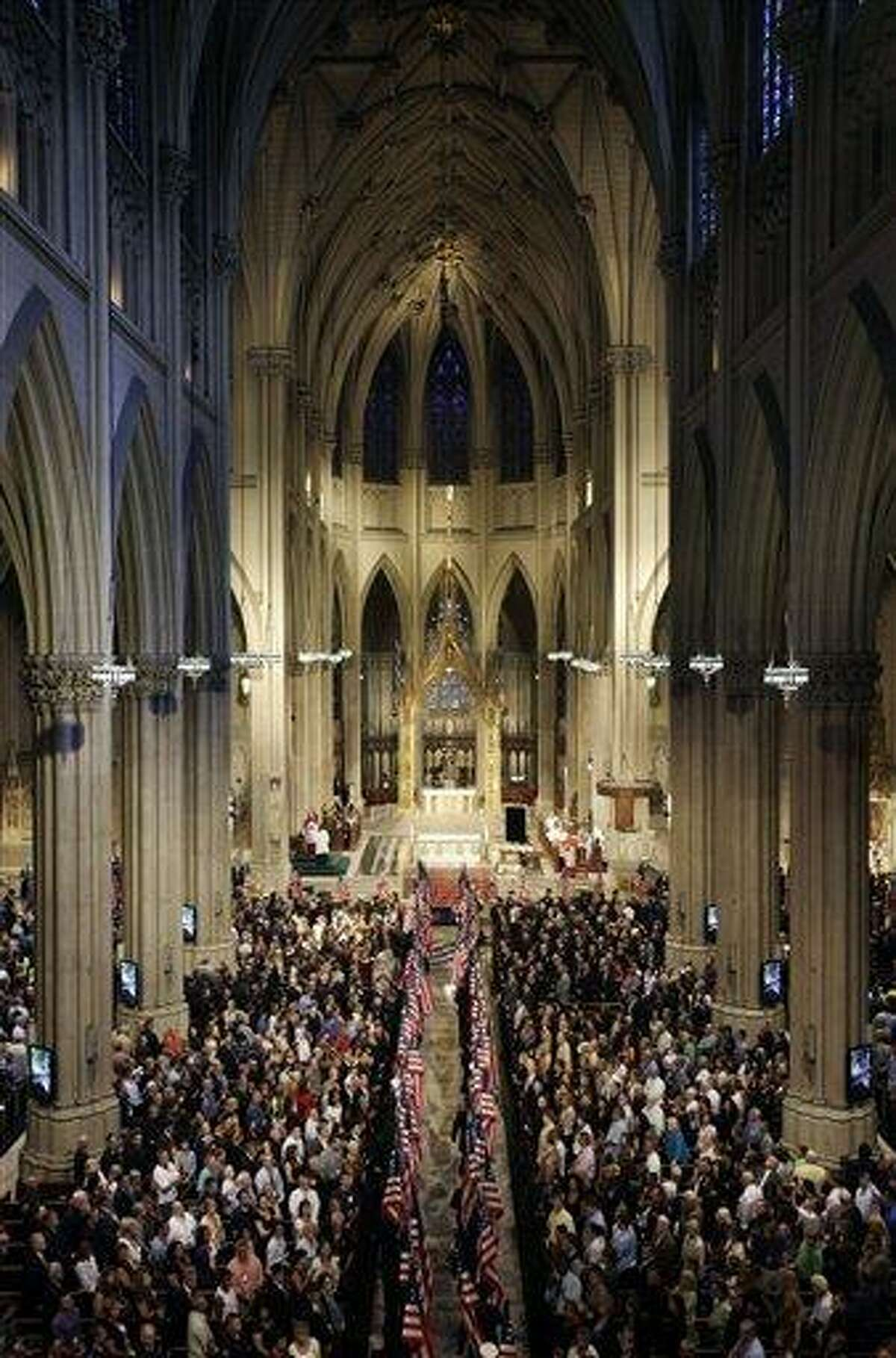 In this 2011 photo, flags are carried into St. Patrick's Cathedral during a ceremony to honor New York firefighters who were killed in the attacks on the World Trade Center in New York. St. Patrick's Cathedral in New York City is embarking on a multimillion-dollar renovation. The $175 million facelift is slated to begin at the end of April and last at least two years. Associated Press