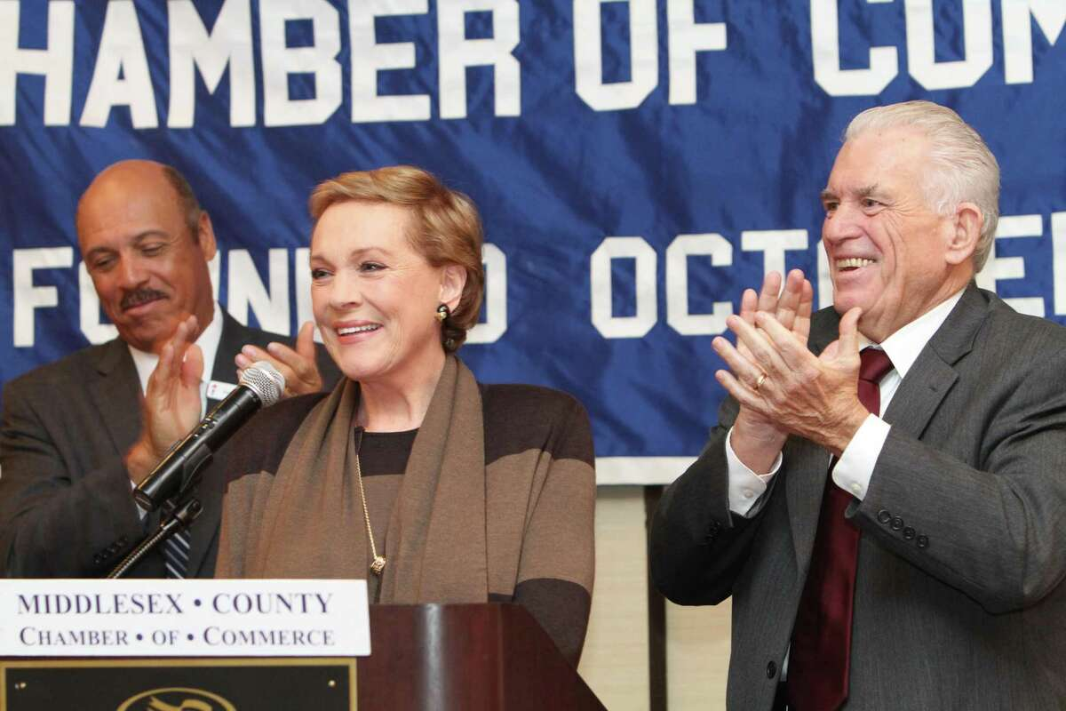 Julie Andrews, center, is the guest of the Middlesex Chamber of Commerce Monday, where she spoke at a special luncheon meeting at the Crowne Plaza Hotel in Cromwell. She is flanked by chamber Chairman Chandler Howard and chamber President Larry McHugh.