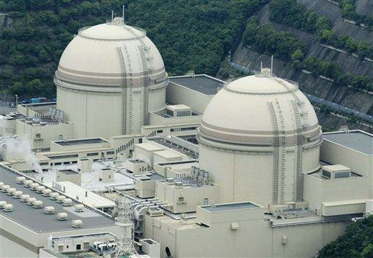 In this Monday file photo, Ohi nuclear power plant's No. 3 rector, right, stands next to No. 4 reactor in Ohi town, Fukui prefecture, western Japan. Associated Press