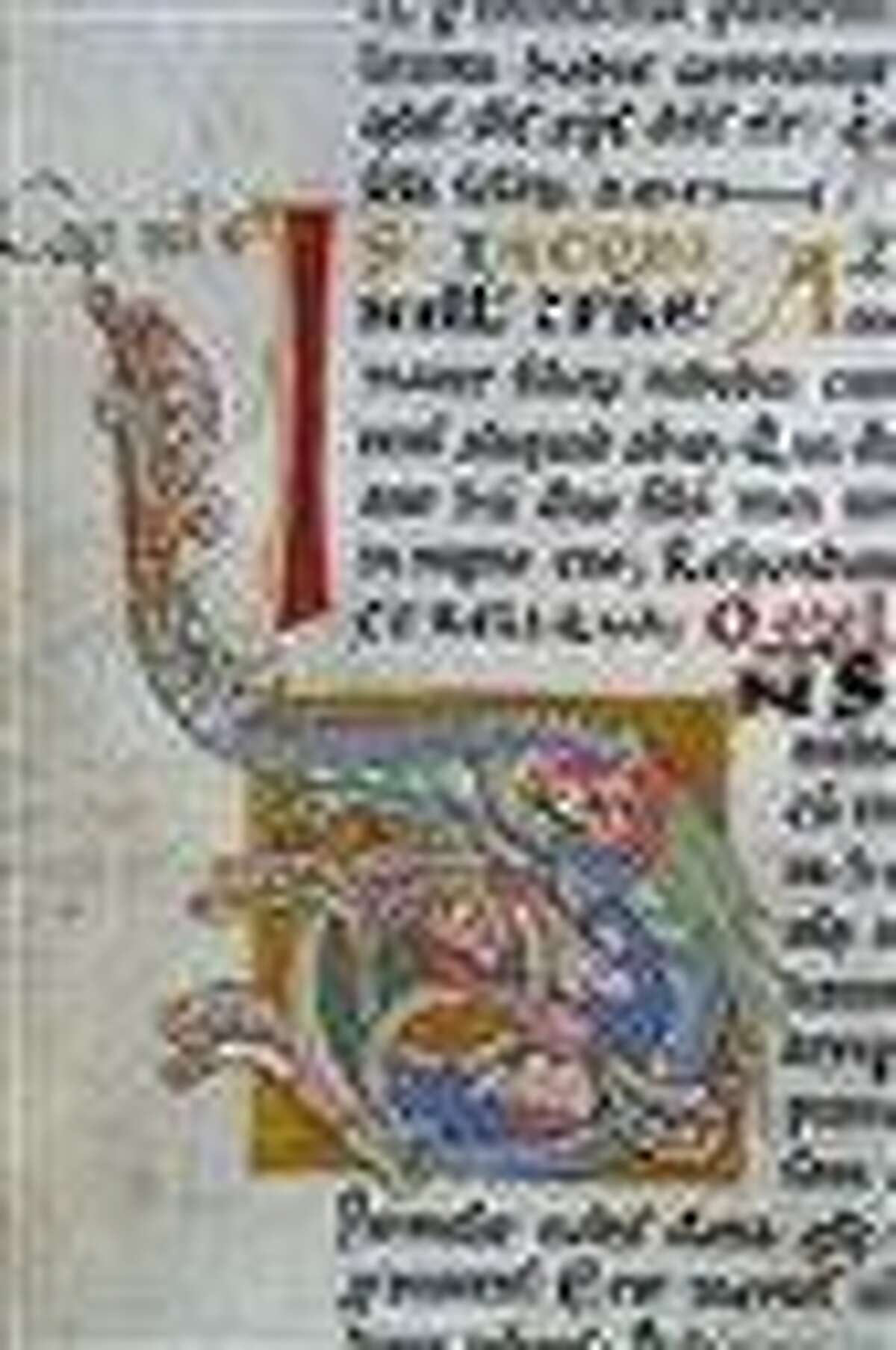 In this photo taken in 2004 in Santiago de Compostela, Spain, one of the pages of the original 12th-century religious Calixtinus Codex manuscript is seen in the cathedral. Spain's Interior Ministry says police have arrested four people in connection with the theft of the priceless collection of religious manuscripts which police say they have now found in a garage. The missing, richly decorated tome, considered the first guide for people making the ancient Christian pilgrimage known as the Camino de Santiago, the Spanish name for the Way of St. James, was stolen a year ago. Associated Press