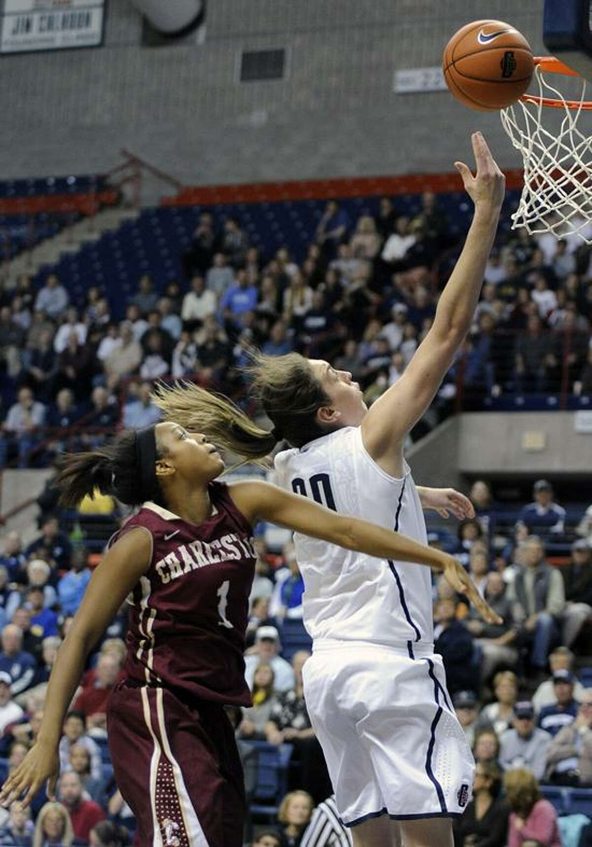 Connecticut's Breanna Stewart, right, drives past Charleston's Alyssa Frye during the first half of an NCAA college basketball game in Storrs, Conn., Sunday, Nov. 11, 2012. Stewart scored a game-high 21 points and Frye a team-high 14 in Connecticut's 103-39 victory. (AP Photo/Fred Beckham)