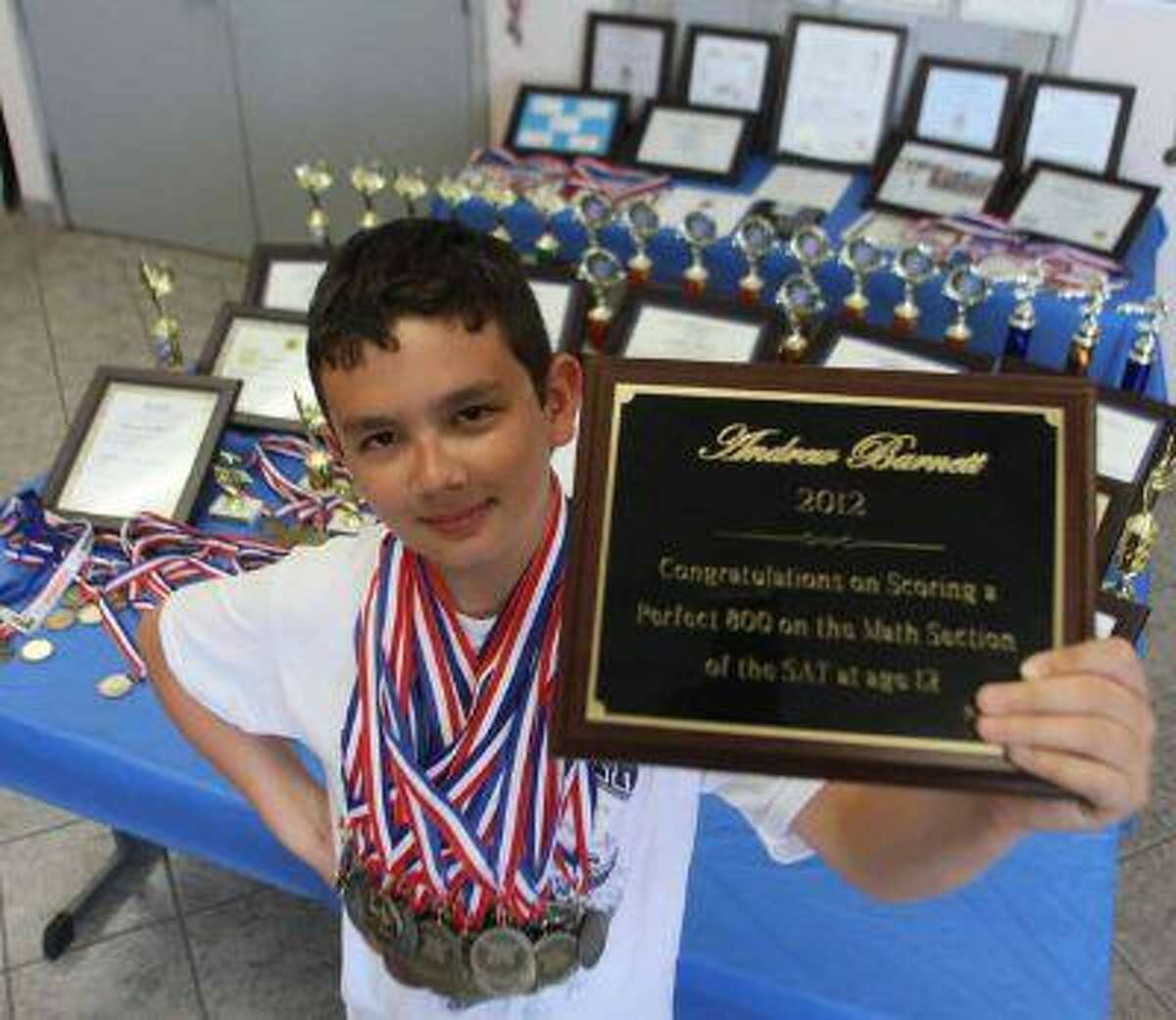 Andrew Barnett shows a plaque which commemorates his perfect 800 score on the SAT. (Victor Calzada/El Paso Times)