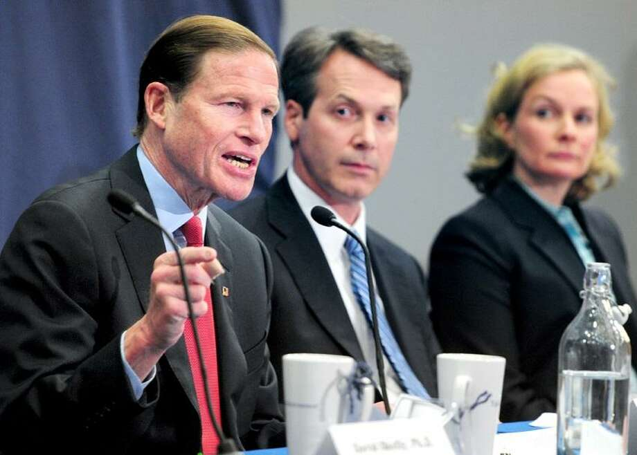 Senator Richard Blumenthal (left) discusses climate change on a panel with Anthony Leiserowitz (center), Director of the Yale Project on Climate Change Communication, and Nadine Unger (right), Assistant Professor of Atmospheric Chemistry, at Kroon Hall at Yale University. Photo by Arnold Gold/Register