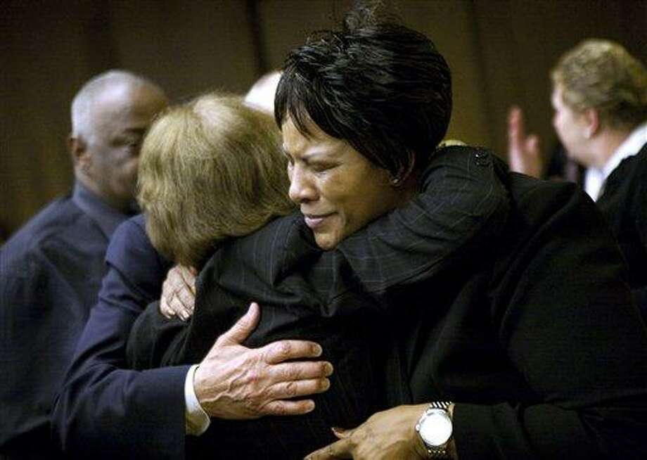 Celeste Peterson, mother of shooting victim Erin Perterson, right, hugs Karen Pryde, mother of shooting victim Julia Pryde, after a verdict on Wednesday in Christiansburg, Va. Jurors sided with the parents of two students who were killed on April 16, 2007, in the most deadly mass shooting in modern U.S. history. Their wrongful death civil lawsuit argued that lives could have been spared if school officials had moved more quickly to alert the campus after the first two victims were shot in a dorm. Associated Press Photo: AP / The Roanoke Times