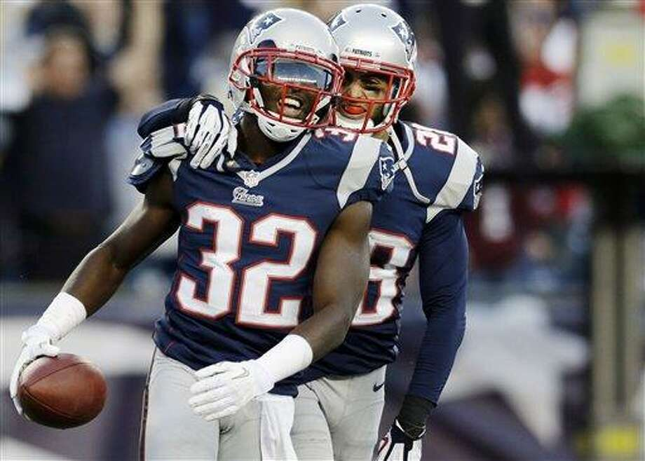 New England Patriots cornerback Devin McCourty (32) celebrates with safety Steve Gregory (28) after he intercepted a pass in the end zone against the Buffalo Bills in the last minutes of an NFL football game at Gillette Stadium in Foxborough, Mass., Sunday, Nov. 11, 2012. The Patriots won 37-31. (AP Photo/Elise Amendola) Photo: ASSOCIATED PRESS / AP2012