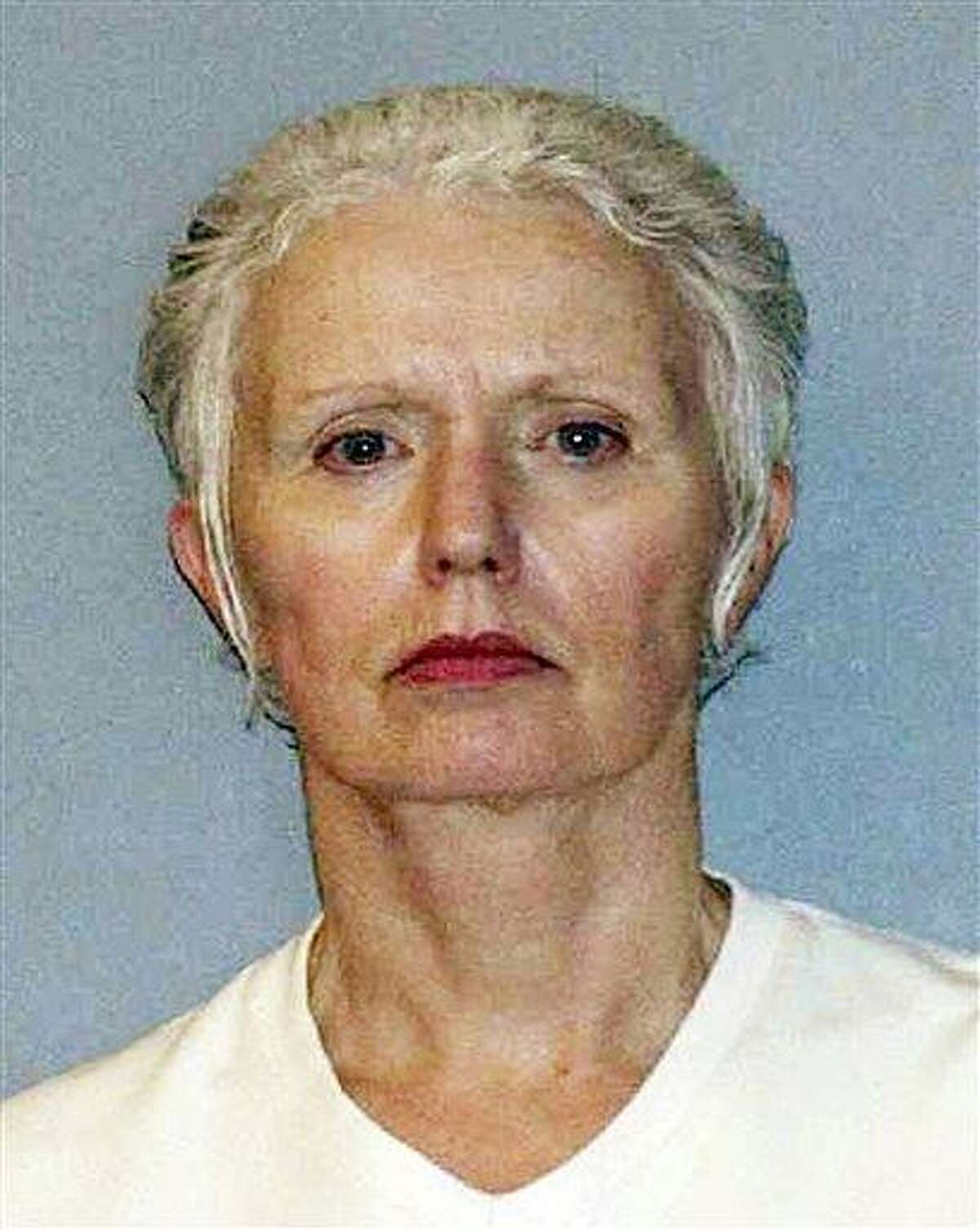 """This undated file photo provided by the U.S. Marshals Service shows Catherine Greig, longtime girlfriend of Whitey Bulger. The brother of one of Bulger's alleged murder victims says that Bulger's girlfriend is a """"monster."""" Associated Press"""