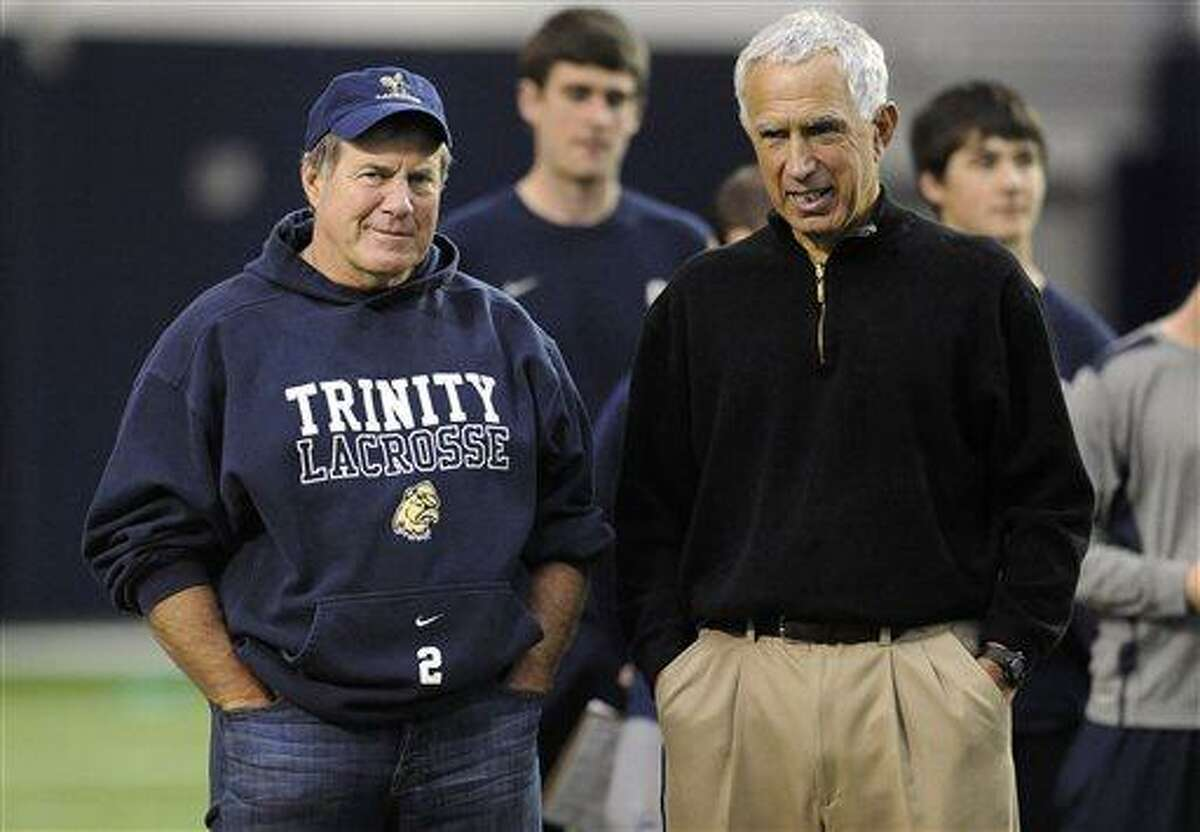 New England Patriots coach Bill Belichick, left, and Connecticut football coach Paul Pasqualoni, right, watch players workout during UConn's NFL football pro day in Storrs, Conn., Wednesday, March 27, 2013. (AP Photo/Jessica Hill)