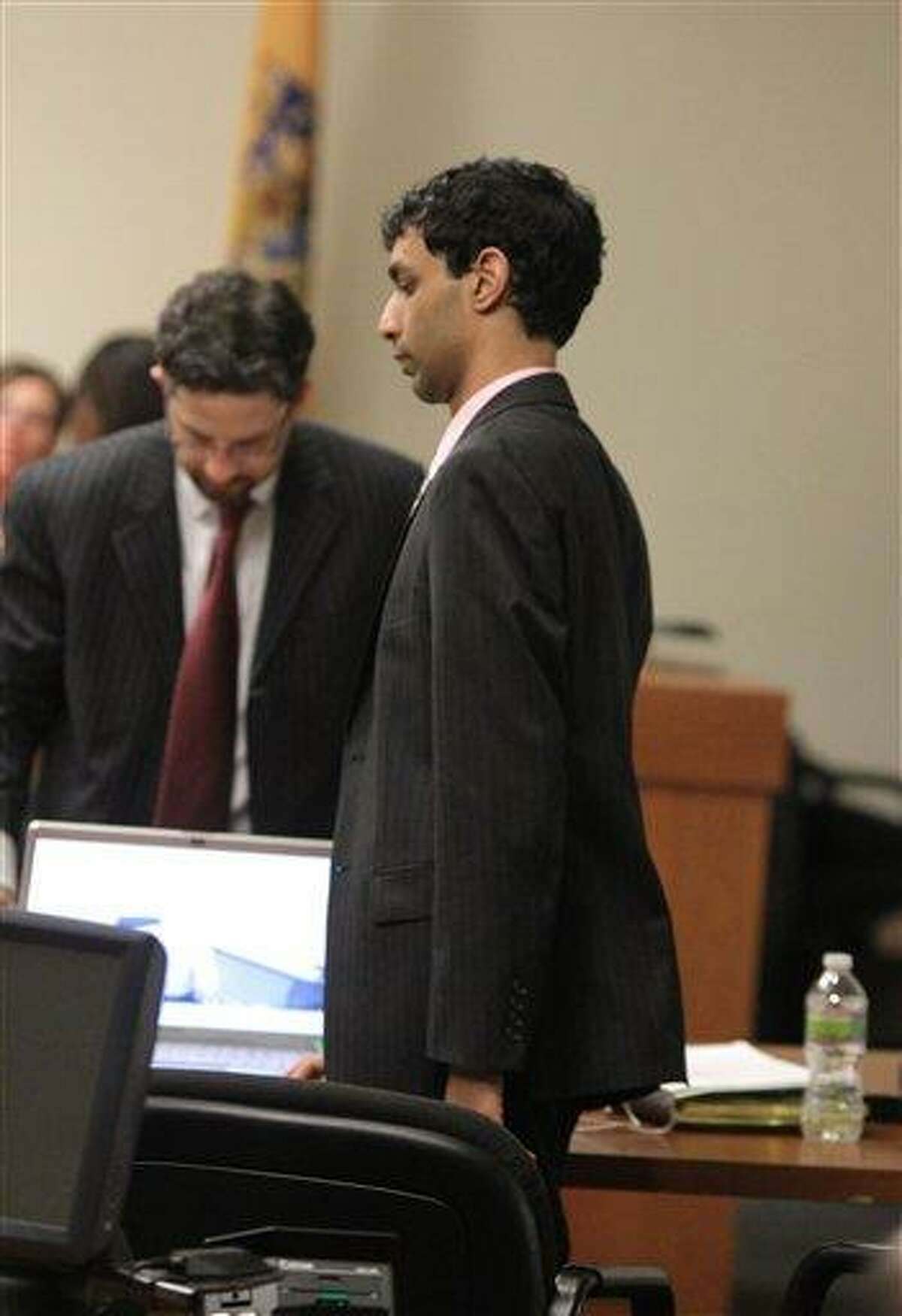 Defense attorney Philip Nettl, left, and former Rutgers student Dharun Ravi wait for the start of summations during Ravi's trial at the Middlesex County Courthouse in New Brunswick, N.J., Tuesday. Associated Press
