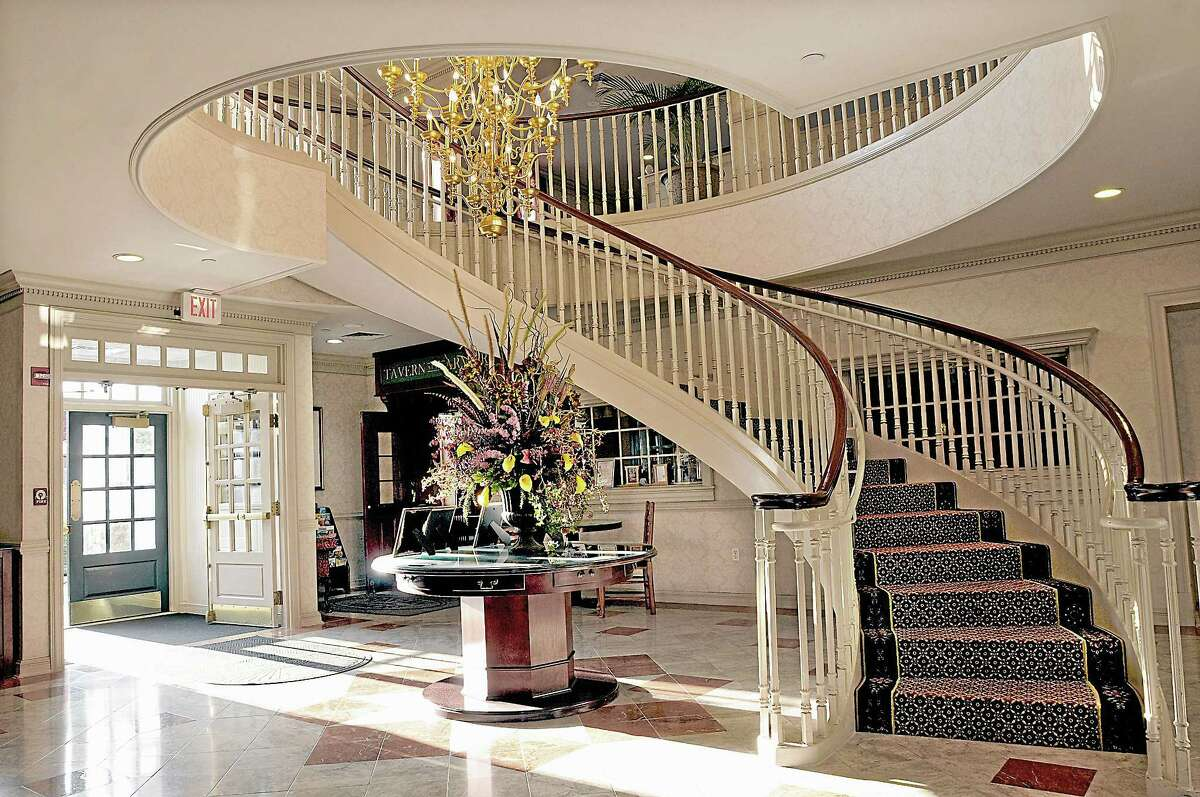 With its grand spiral staircase and chandelier taking center stage in the front lobby, the former armory offers a mix of history and modern amenities.