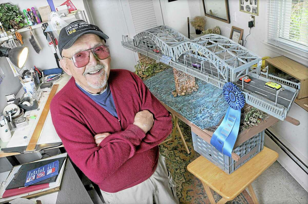 Joseph Virgadula, 80, in his design studio at his Portland home with his award-winning model of the Middletown-Portland Arrigoni Bridge. The bridge construction began in 1936 and completed in 1938. With two 600-foot steel arches, the bridge is still the longest of its kind in Connecticut and was the most expensive bridge, costing $3.5 million. Virgadula, who has macular degeneration, spent one month designing his model bridge and spent three months constructing the little Arrigoni, using everything from cuttings of balsa wood, to toothpicks and wooden paint stirrers.