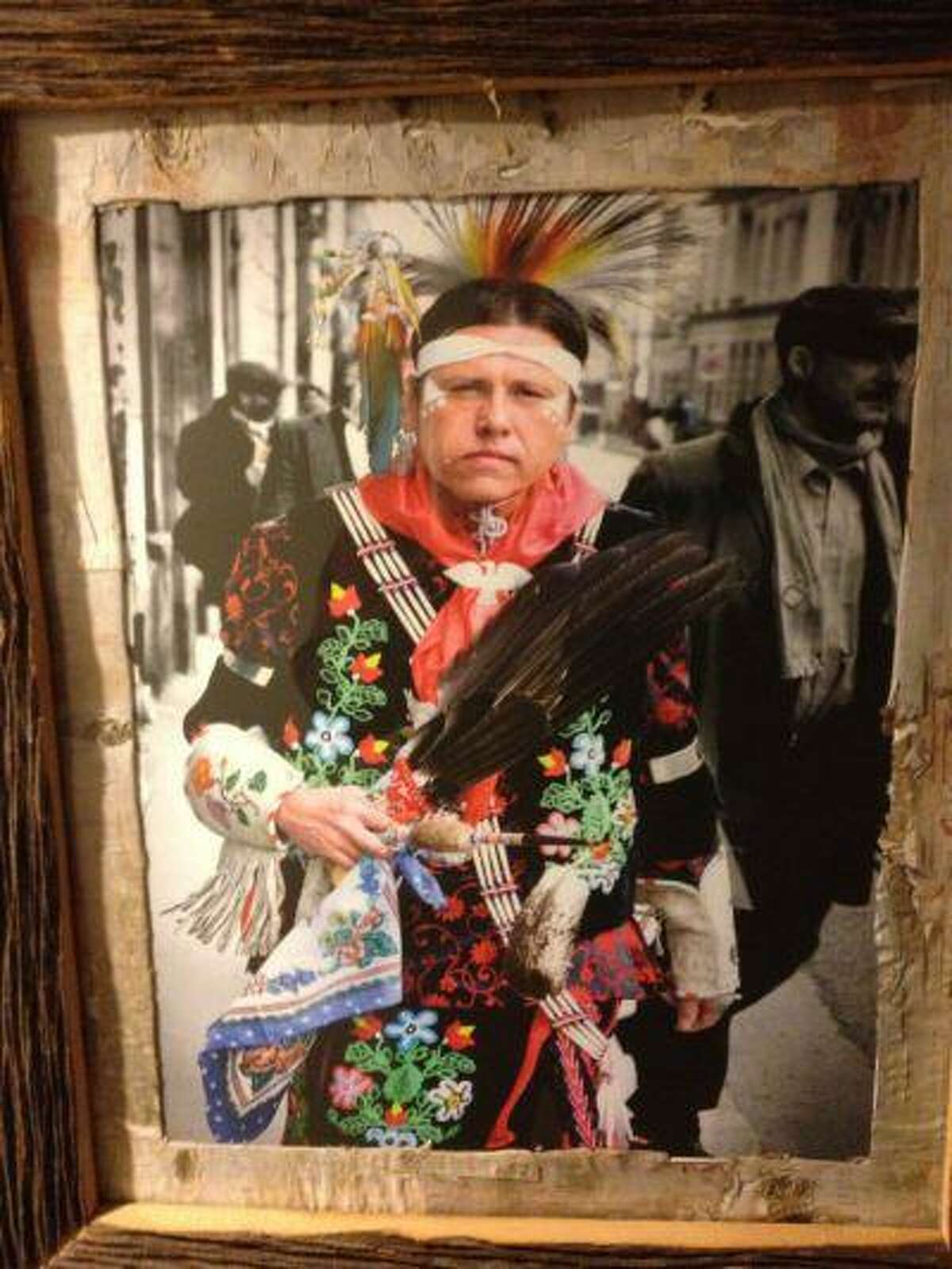 A portrait of a First Nation brave hangs on the wall of Keriwa Cafe, a restaurant in Toronto.