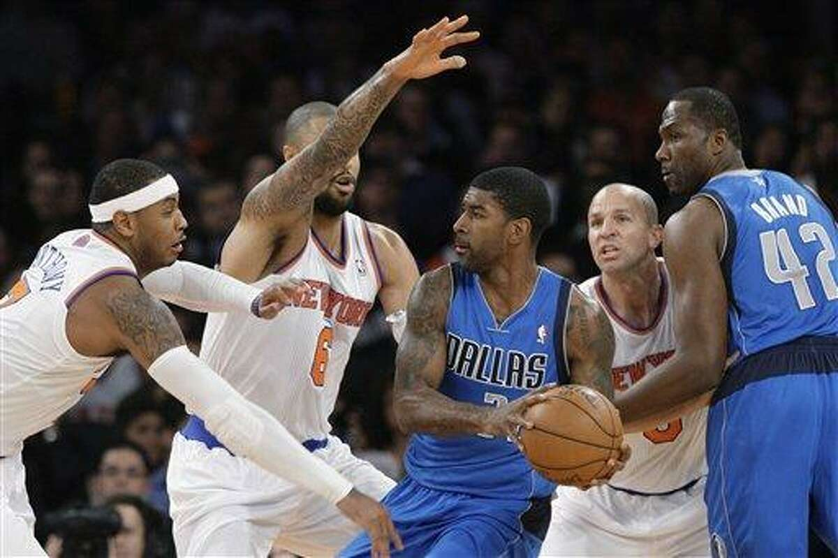 Dallas Mavericks' O.J. Mayo (32) looks to pass away from New York Knicks' Carmelo Anthony, left, Tyson Chandler, center left, and Jason Kidd, second from right, as Mavericks' Elton Brand, right, sets a pick during the first half of an NBA basketball game Friday, Nov. 9, 2012, in New York. (AP Photo/Frank Franklin II)