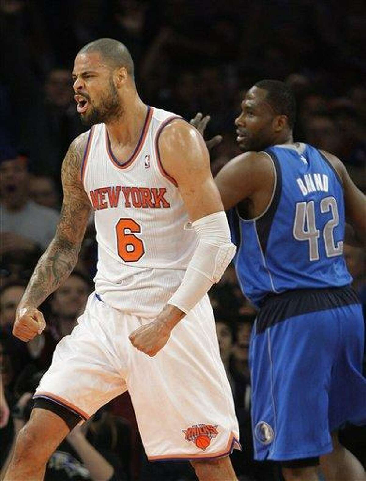 New York Knicks' Tyson Chandler (6) and Dallas Mavericks' Elton Brand (42) react to a play during the second half of an NBA basketball game Friday, Nov. 9, 2012, in New York. The Knicks won 104-94. (AP Photo/Frank Franklin II)