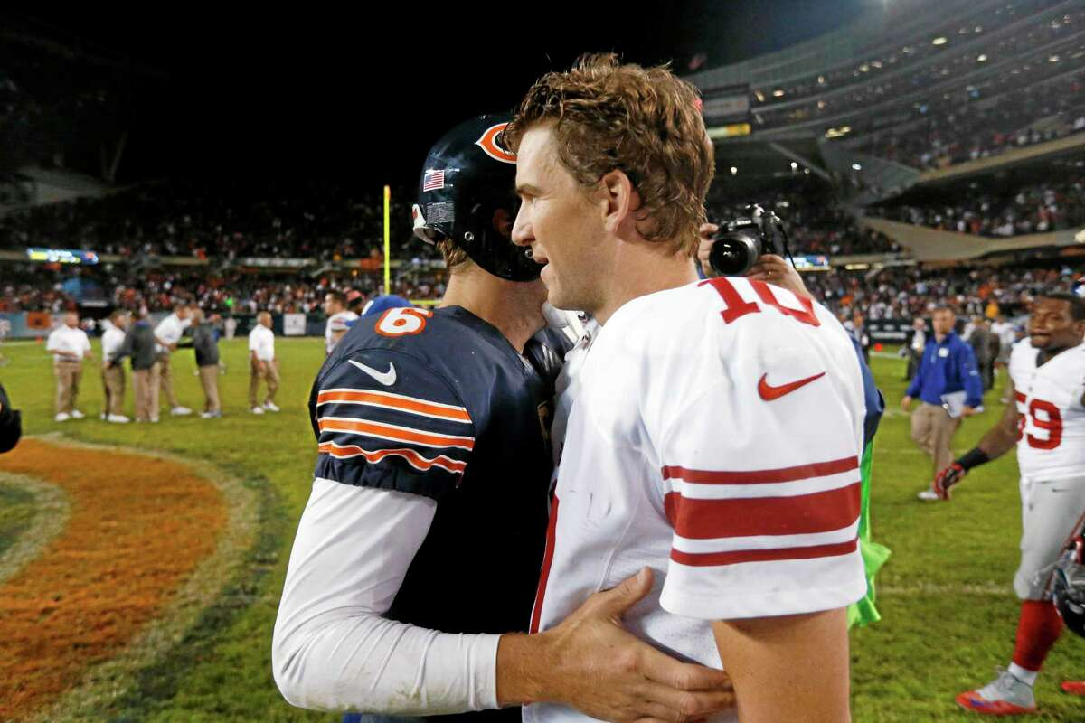 New York Giants quarterback Eli Manning congratulates Bears quarterback Jay Cutler after their Oct. 10 game in Chicago. The Bears won 27-21.