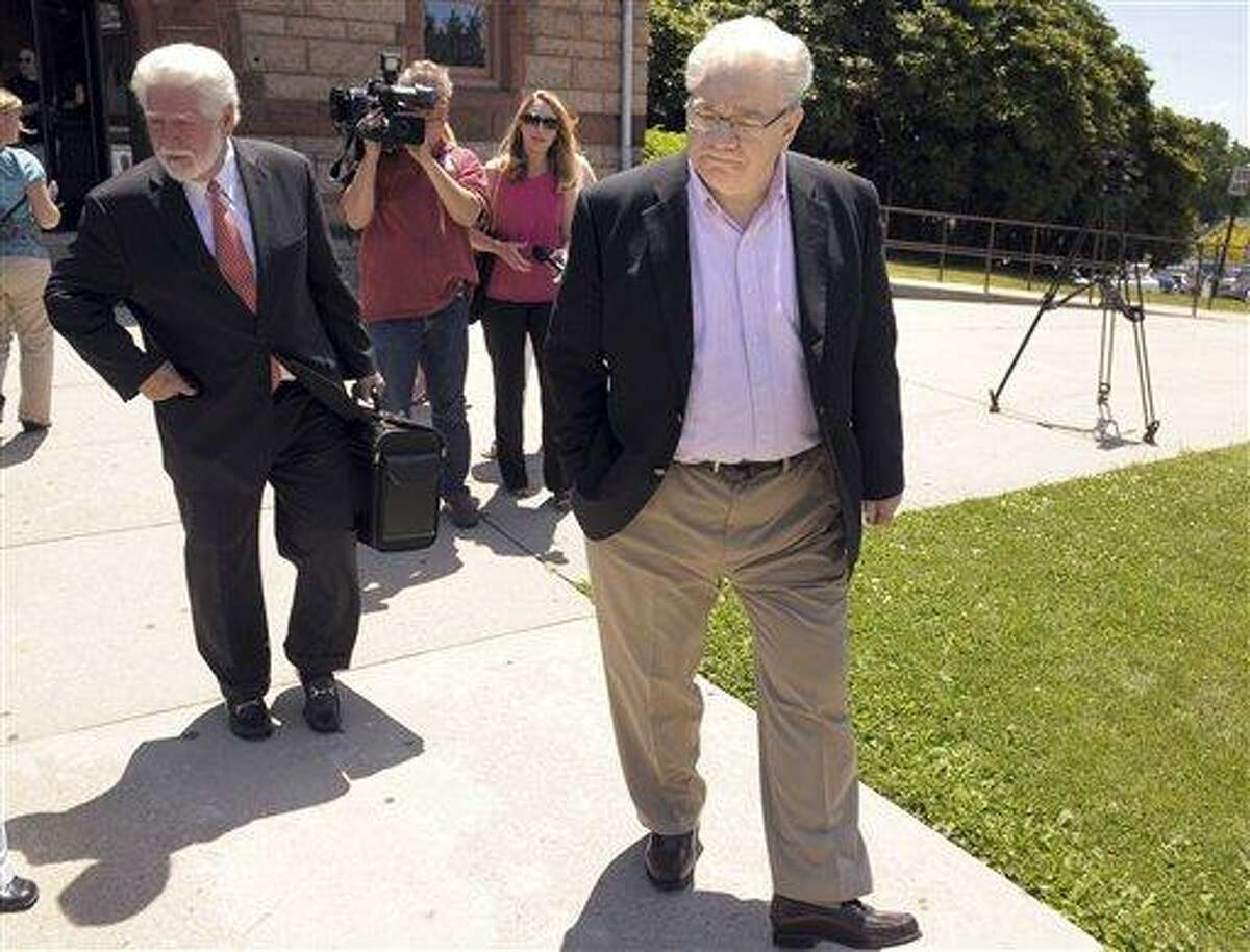 The Rev. Dennis Carey, former pastor of St. Paul in Chains Church of Waterford, departs Connecticut Superior Court in New London Tuesday. He was arraigned on a single charge of possessing child pornography in the first degree. He was ordered to have no contact with minors and not use computers. Associated Press