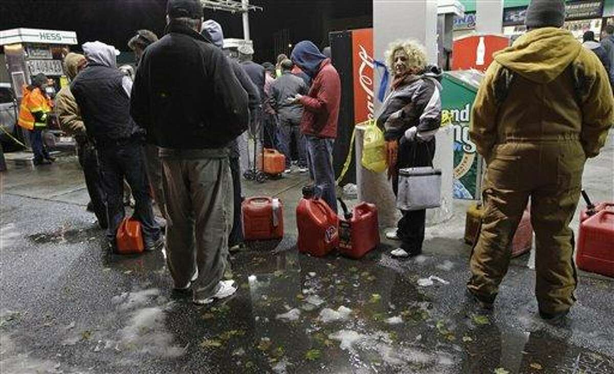 People wait in line for gasoline at a Hess station in Brooklyn Thursday where gas is still scarce in New York. Fuel shortages and distribution delays that led to gas hoarding have prompted New York City and Long Island to initiate an even-odd gas rationing plan which begins Friday at 6 a.m. in New York and 5 a.m. in Long Island. Associated Press
