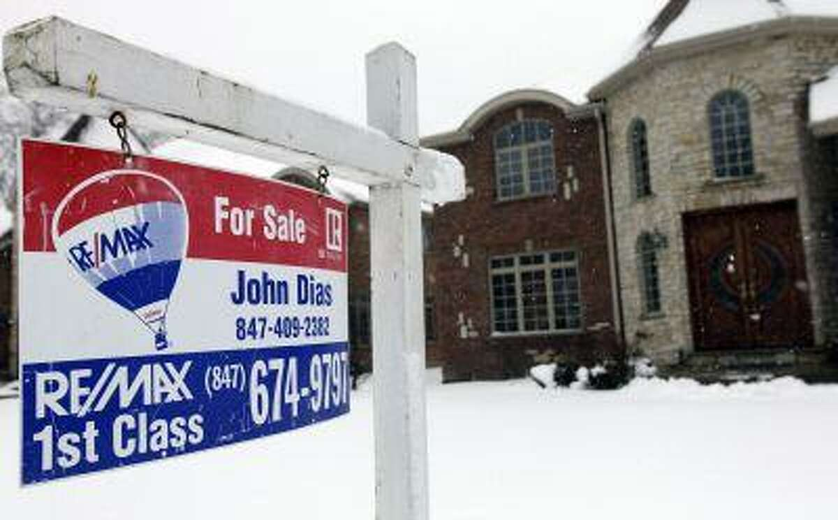 """In this Feb. 27, photo, a """"for sale"""" sign is seen outside a home in Glenview, Ill. (AP Photo/Nam Y. Huh)"""