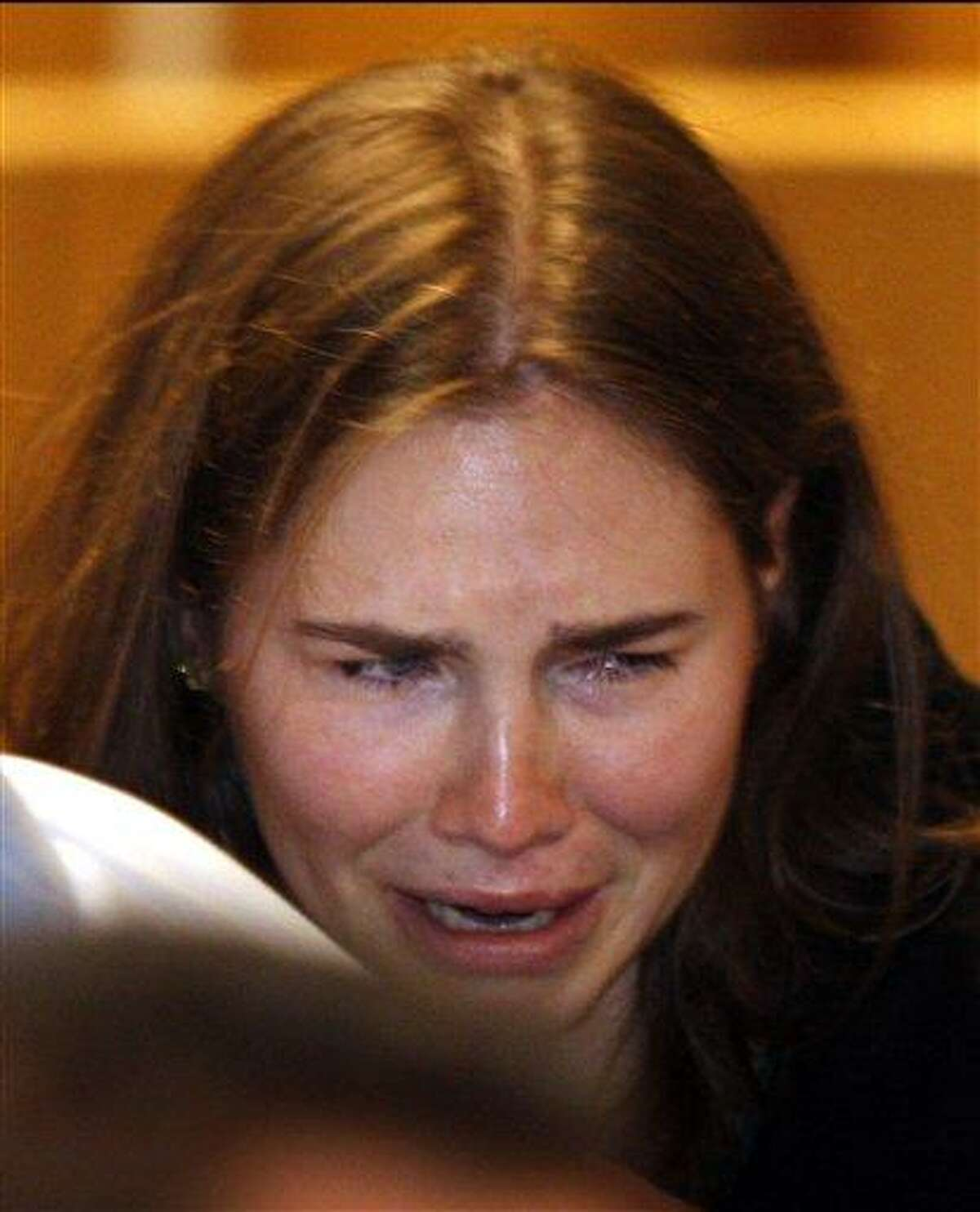 FILE - This is a Monday, Oct. 3, 2011 file photo of Amanda Knox as she breaks into tears after hearing the verdict that overturns her conviction and acquits her of murdering her British roommate Meredith Kercher, at the Perugia court, central Italy. Italy's highest criminal court Tuesday March 26, 2013 has ordered a new trial in the case of Amanda Knox in the slaying of her British roommate. The court ruled that an appeals court in Florence must re-hear the case against the American and her Italian-ex-boyfriend. Knox has been living back in the U.S. while her former boyfriend continues studies in Italy. (AP Photo/Pier Paolo Cito, File)