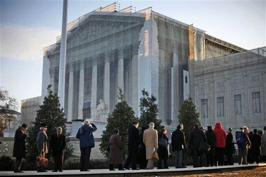 People line up for entrance into the Supreme Court in Washington, Tuesday, March 26, 2013, where the court will hear arguments on California's voter approved ban on same-sex marriage, Proposition 8. (AP Photo/Pablo Martinez Monsivais) Photo: AP / AP