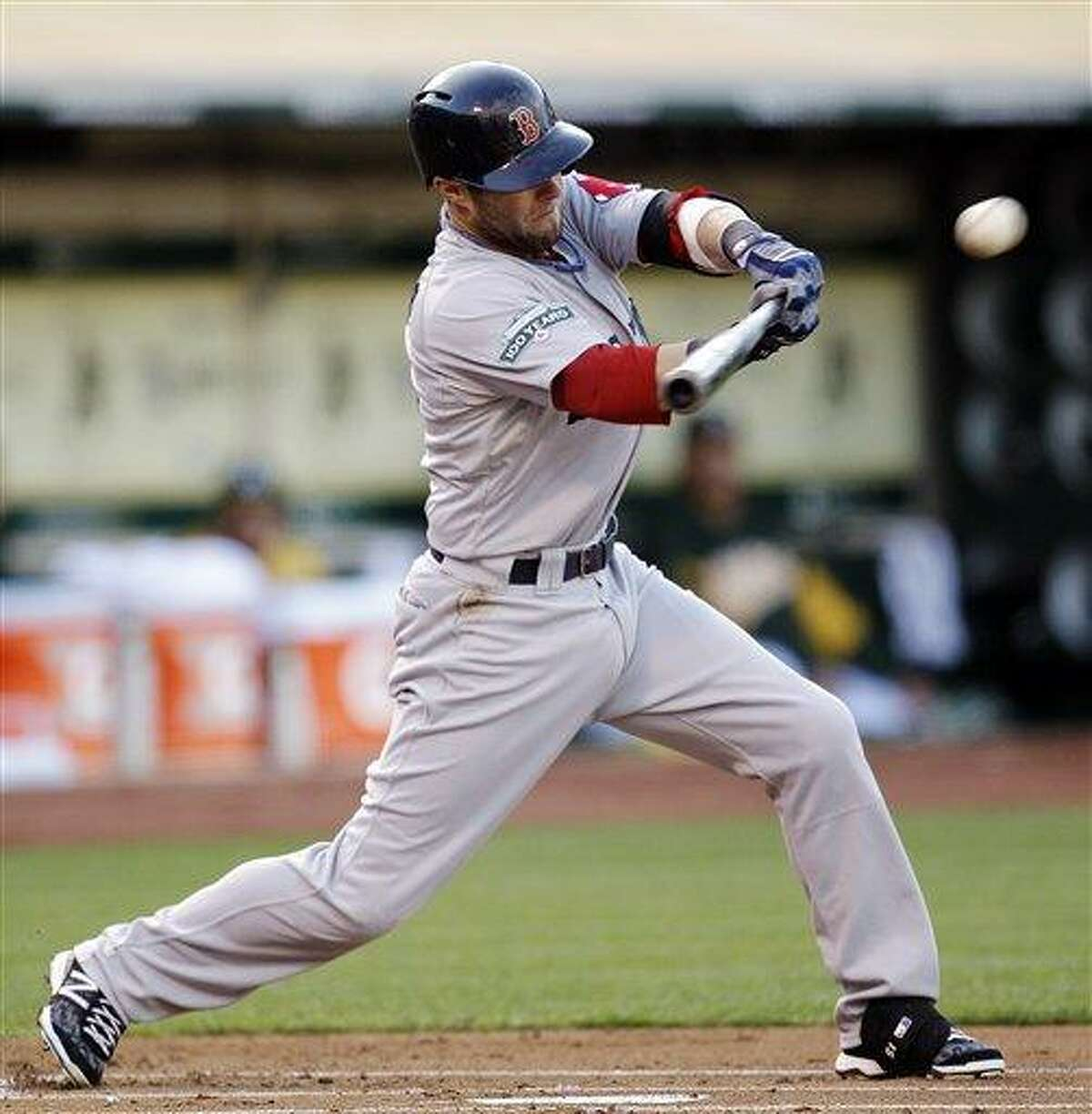 Boston Red Sox's Dustin Pedroia connects for an RBI single off Oakland Athletics' Jarrod Parker in the first inning of a baseball game, Monday, July 2, 2012, in San Francisco. (AP Photo/Ben Margot)