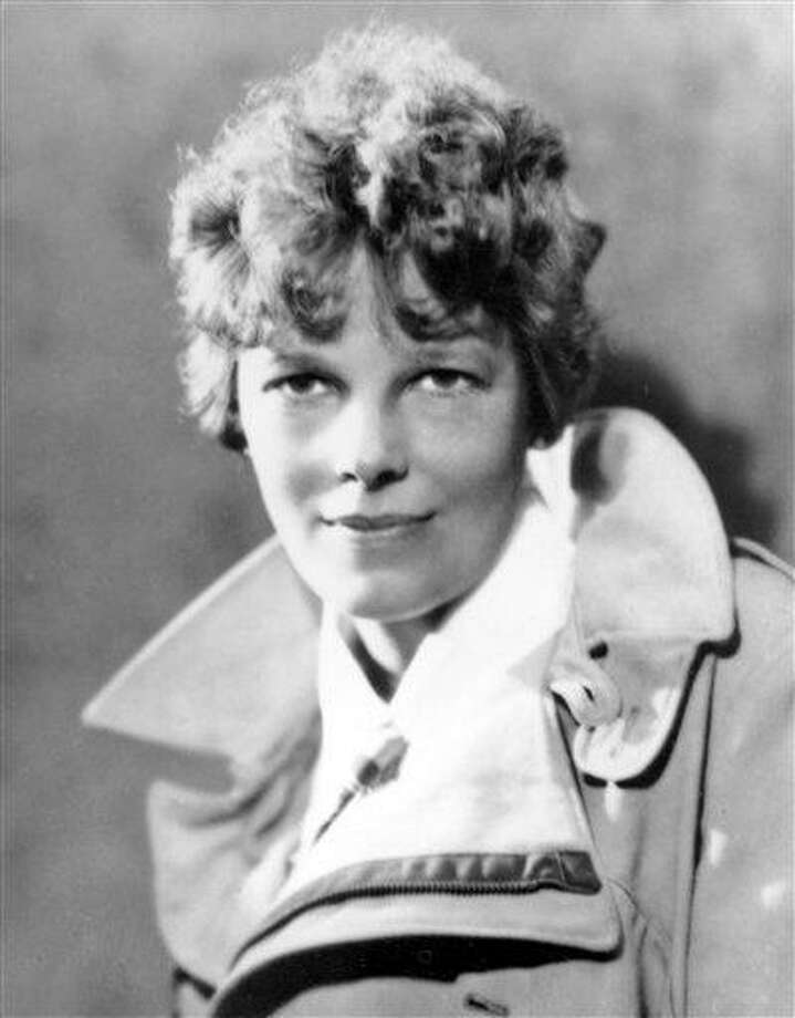 An undated file photo shows American aviatrix Amelia Earhart.  A $2.2 million expedition is hoping to finally solve one of America's most enduring mysteries: What happened to Earhart when she went missing over the South Pacific 75 years ago?  Associated Press Photo: AP / AP