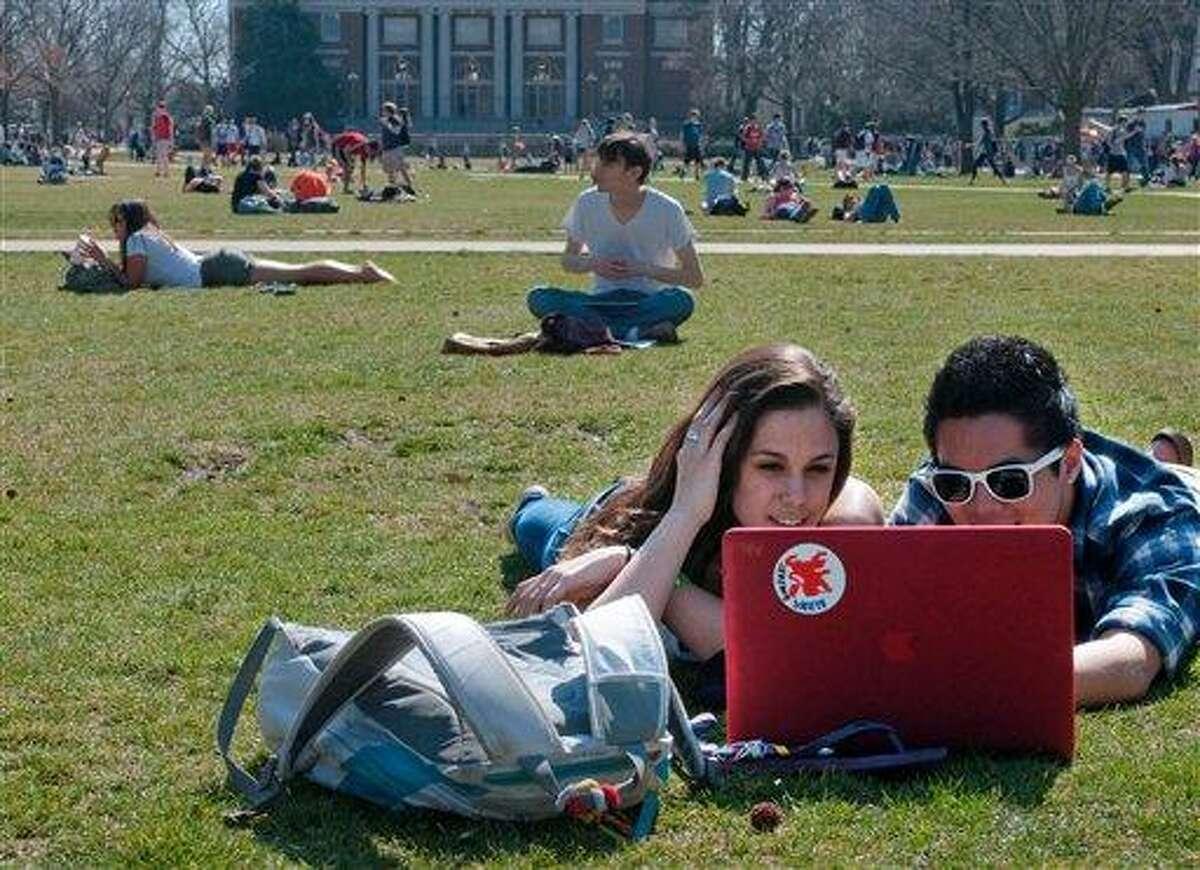 University of Illinois freshmen Jill Marik, left, and Jeremy Vivit enjoy the weather and study on the Quad on the Illinois campus in Urbana, Ill., Tuesday. Associated Press