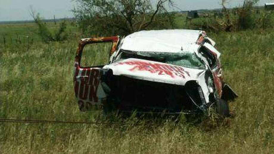In this June 2, 2013 image taken from video in Union City, Okla., shows the vehicle that longtime storm chasers Tim Samaras, his son Paul and colleague Carl Young were killed in Friday when a powerful tornado hit near El Reno, Okla. (AP Photo/John L. Mone) Photo: AP / AP